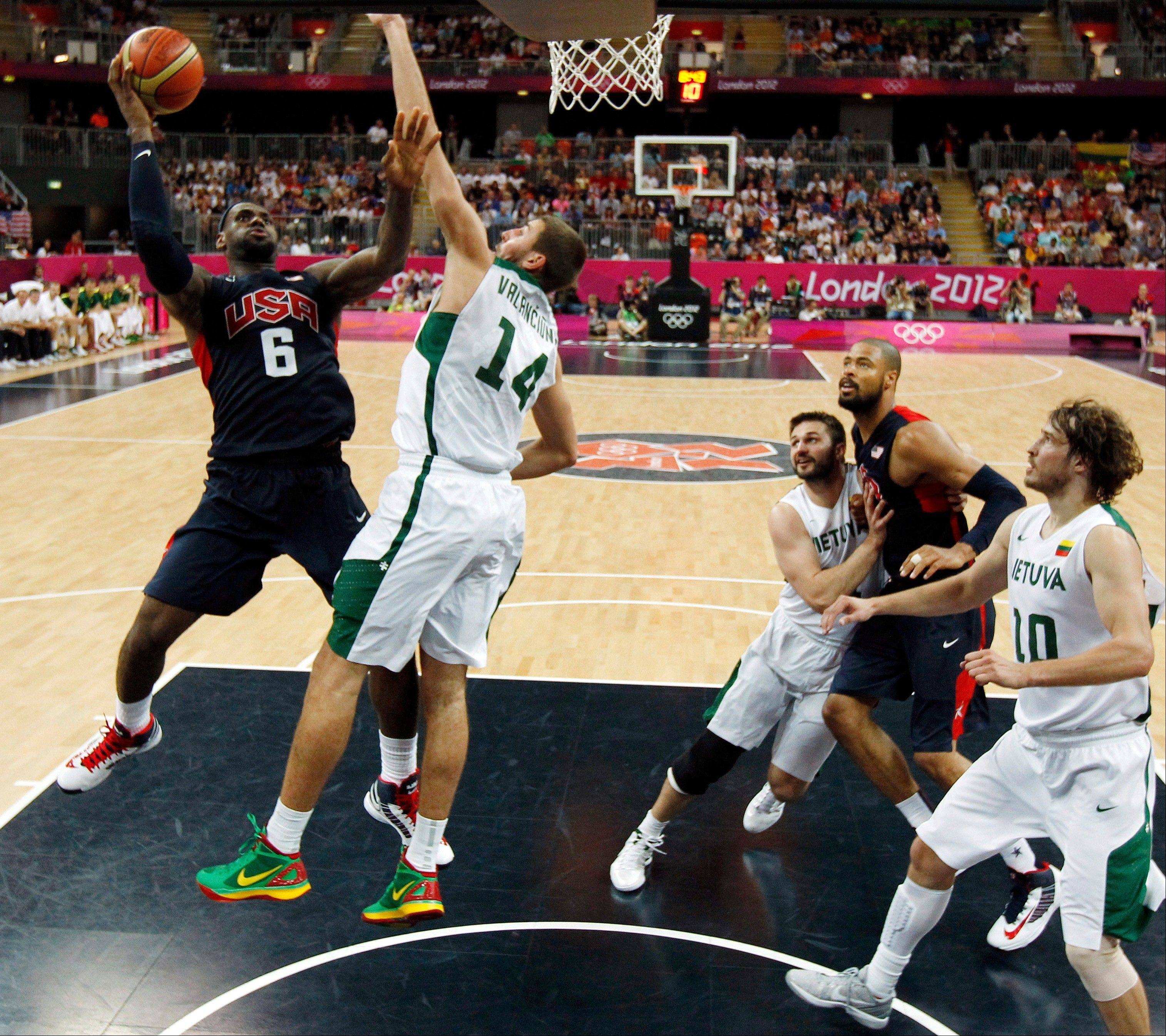United States' Lebron James (6) shoots over Lithuania's Jonas Valanciunas (14) during their men's preliminary round basketball game at the 2012 Summer Olympics on Saturday, Aug. 4, 2012, in London.