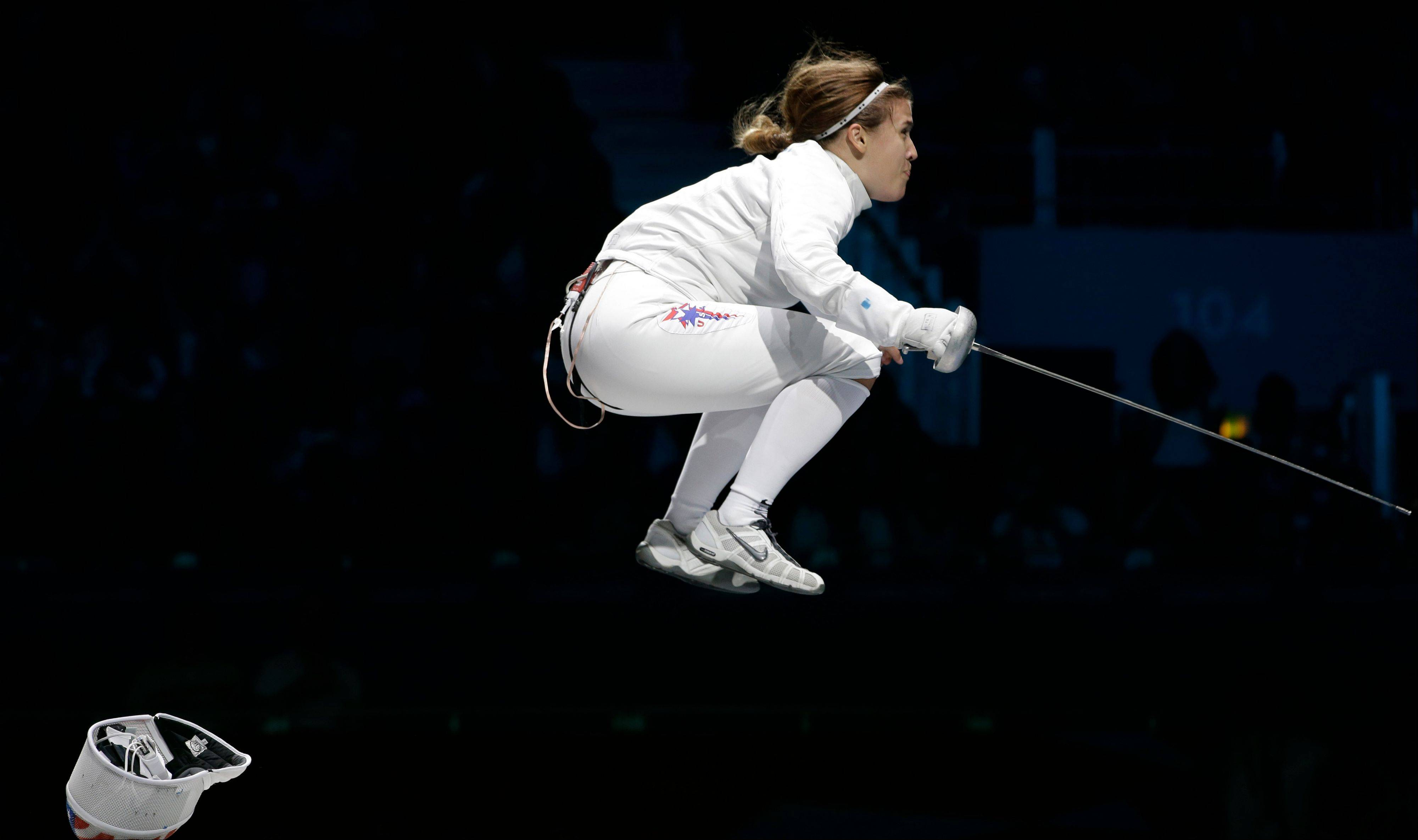 United States' Courtney Hurley celebrates after her team defeated Russia in the bronze medal match in women's team epee fencing competition at the 2012 Summer Olympics, Saturday, Aug. 4, 2012, in London.