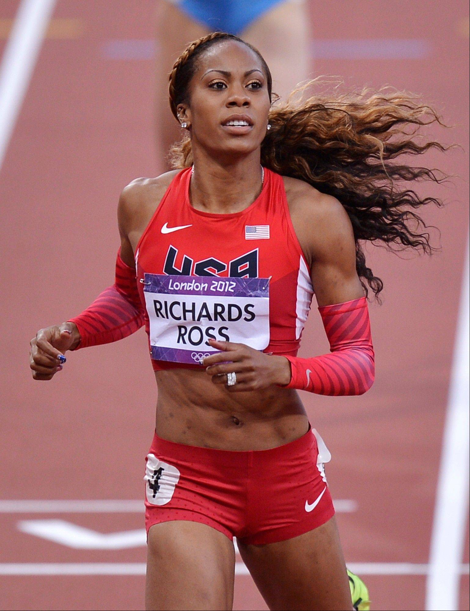 United States' Sanya Richards-Ross crosses the finish line in a women's 400-meter semifinal during the athletics in the Olympic Stadium at the 2012 Summer Olympics, London, Saturday, Aug. 4, 2012.