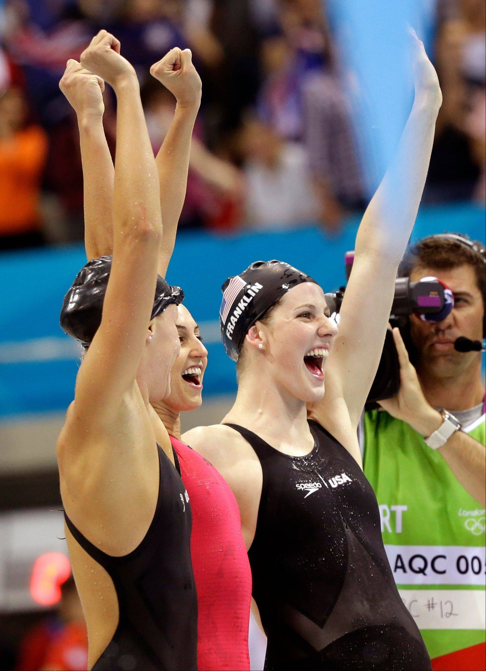 United States' women's 4 x 100-meter medley relay team Dana Vollmer, right, Rebecca Soni, center, and Missy Franklin, left, celebrate as their teammate finishes, winning the yeam a gold medal, at the Aquatics Centre in the Olympic Park during the 2012 Summer Olympics in London, Saturday, Aug. 4, 2012.