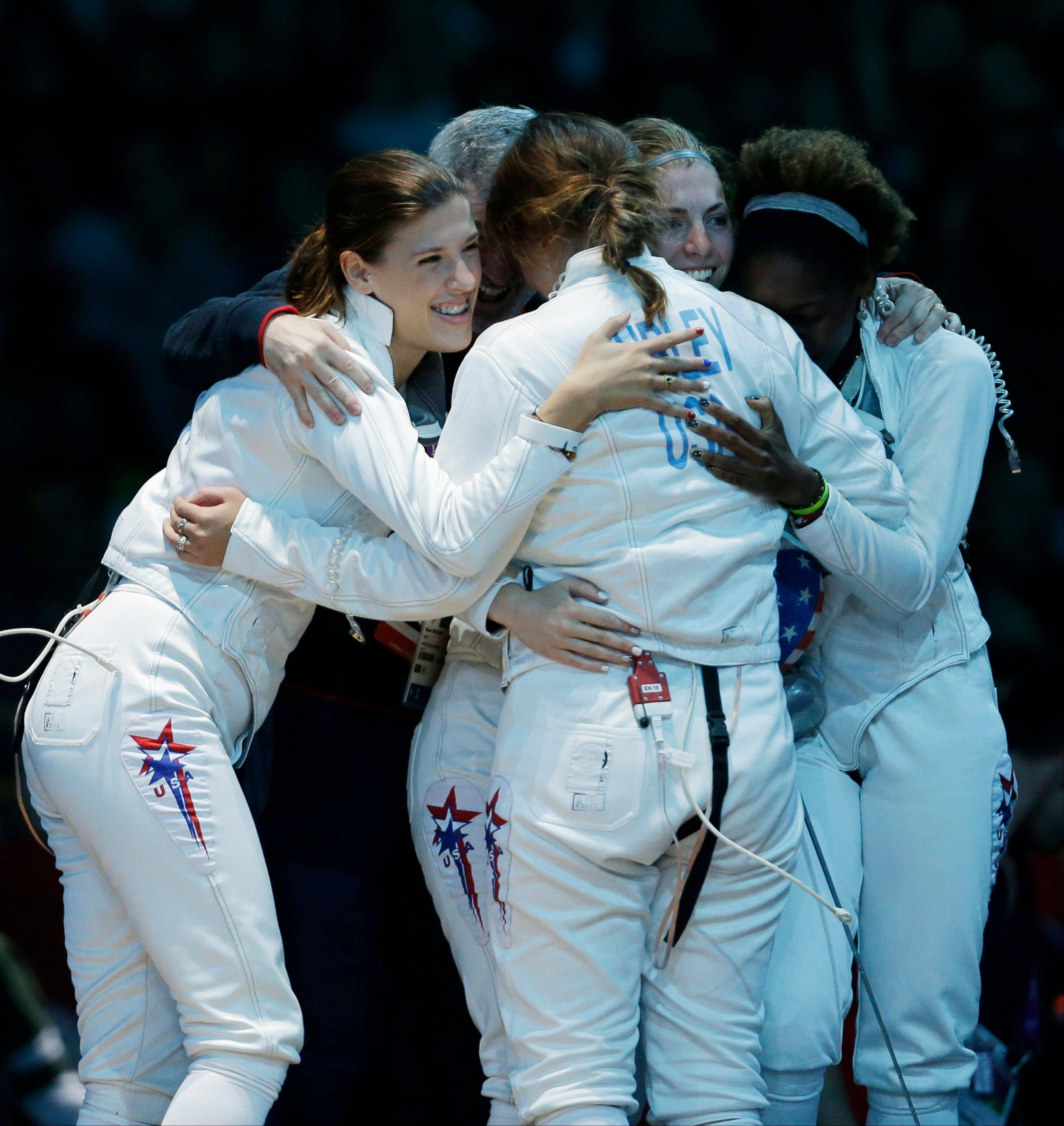 United States players celebrates after defeating Italy in women's team epee fencing at the 2012 Summer Olympics, Saturday, Aug. 4, 2012, in London.