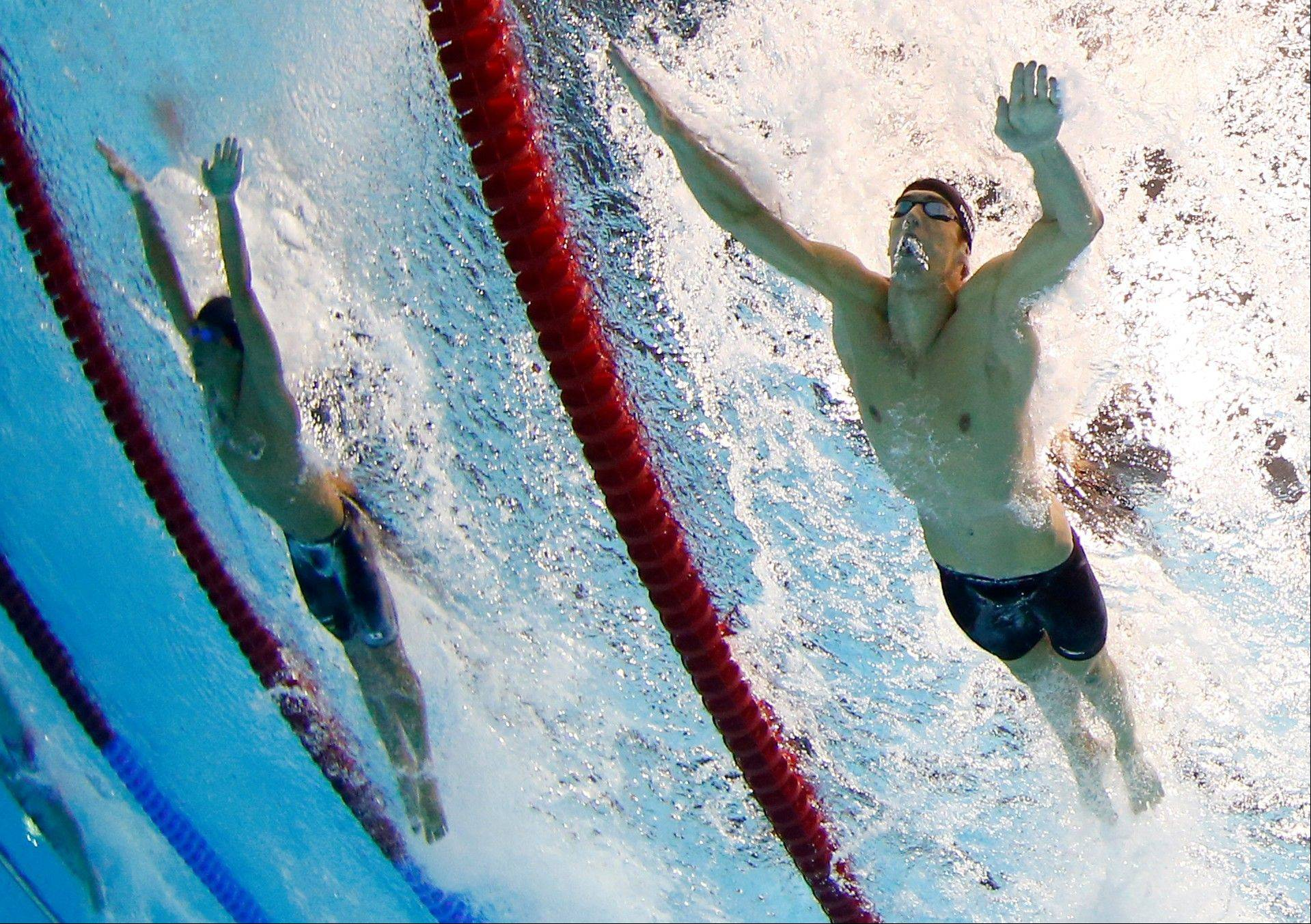 United States' Michael Phelps, right, swims in the men's 4 X 100-meter medley relay final at the Aquatics Centre in the Olympic Park during the 2012 Summer Olympics in London, Saturday, Aug. 4, 2012. Phelps pushed the United States in front to win the medley relay Saturday in the final swimming event of the London Games, after which he is retiring. He leaves the sport with a record 18 golds and 22 medals overall.