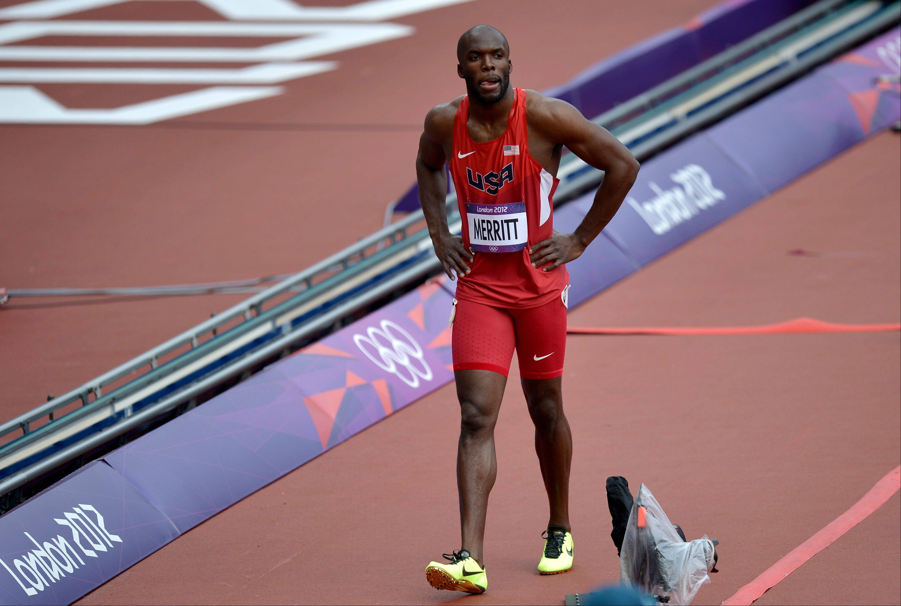 United States' LaShawn Merritt walks with an injured hamstring following his heat of the men's 400 meters during the athletics in the Olympic Stadium at the 2012 Summer Olympics, London, Saturday, Aug. 4, 2012.