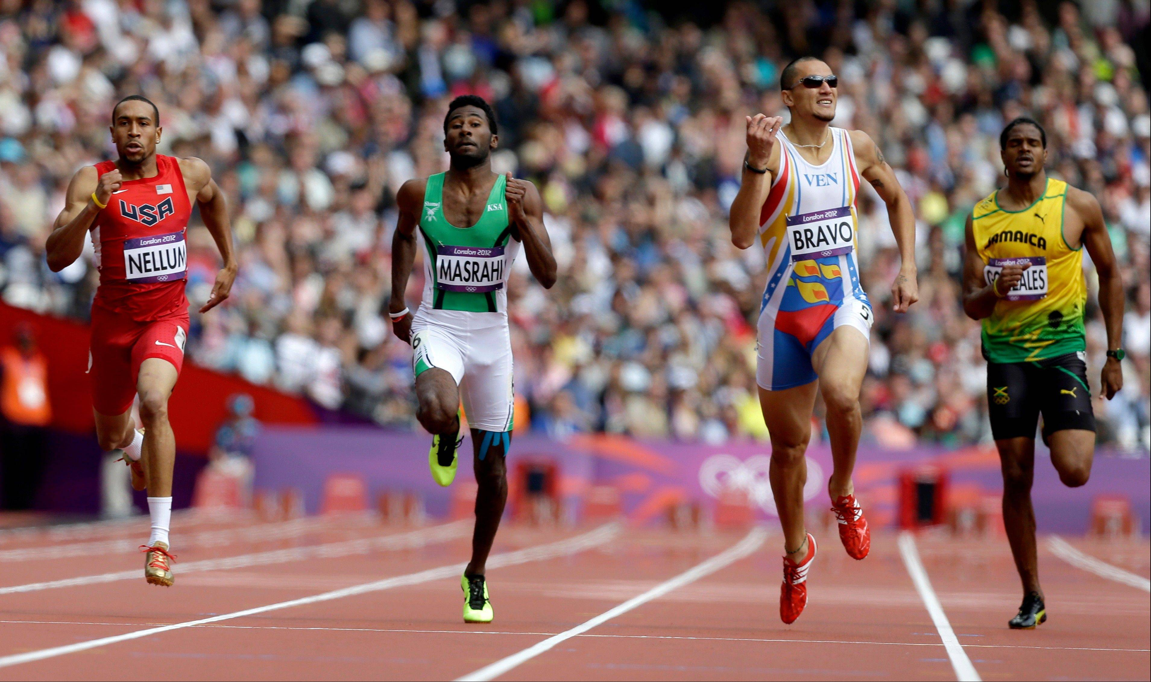 From left, United States' Bryshon Nellum,Saudi Arabia's Yousef Ahmed Masrahi, Venezuela's Albert Bravo, Jamaica's Jermaine Gonzales compete in a men's 400-meter heat during the athletics in the Olympic Stadium at the 2012 Summer Olympics, London, Saturday, Aug. 4, 2012.