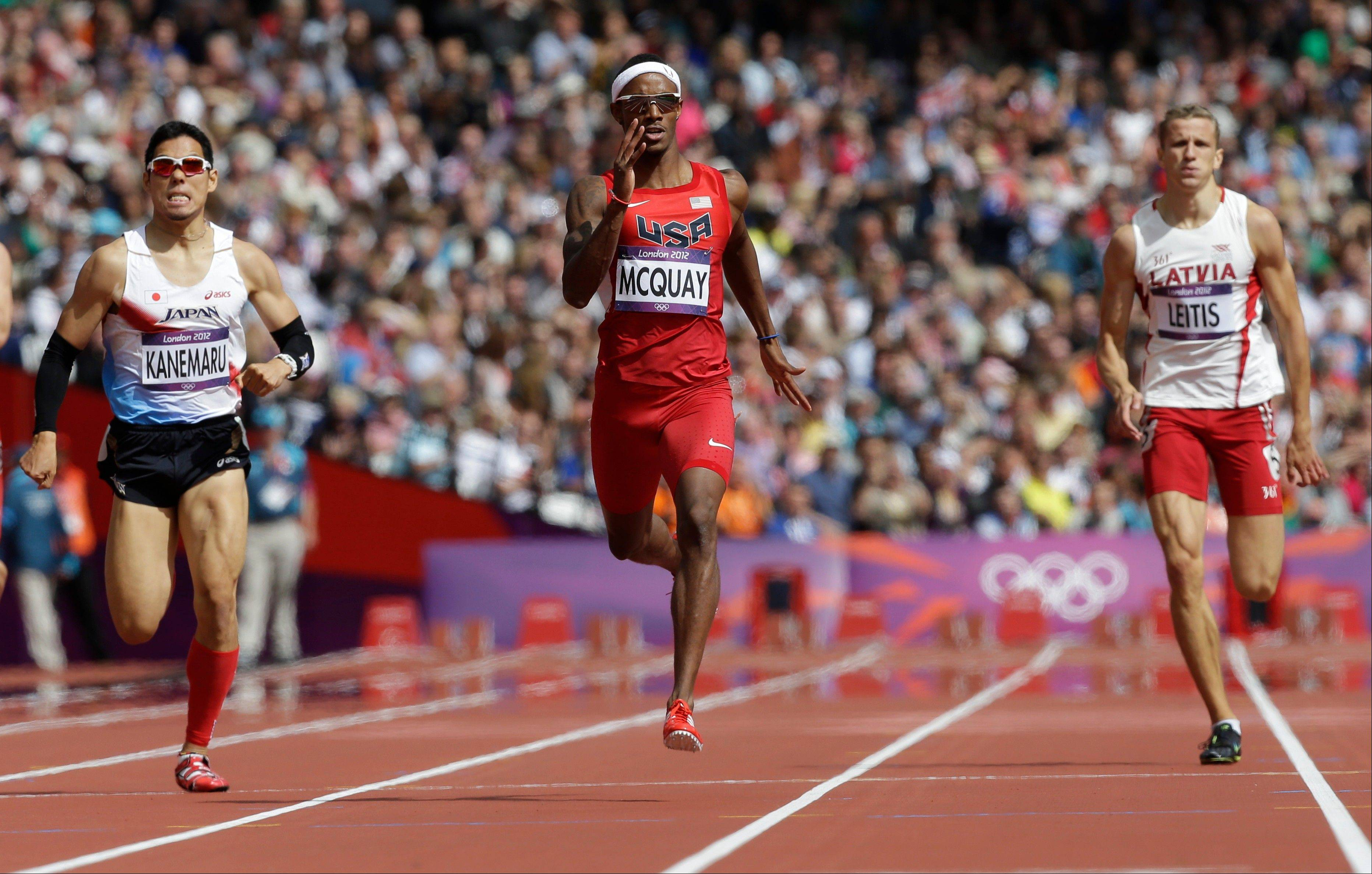 FRom left, Japan's Yuzo Kanemaru, United States' Tony McQuay, Latvia's Janis Leitis compete in a men's 400-meter heat during the athletics in the Olympic Stadium at the 2012 Summer Olympics, London, Saturday, Aug. 4, 2012.
