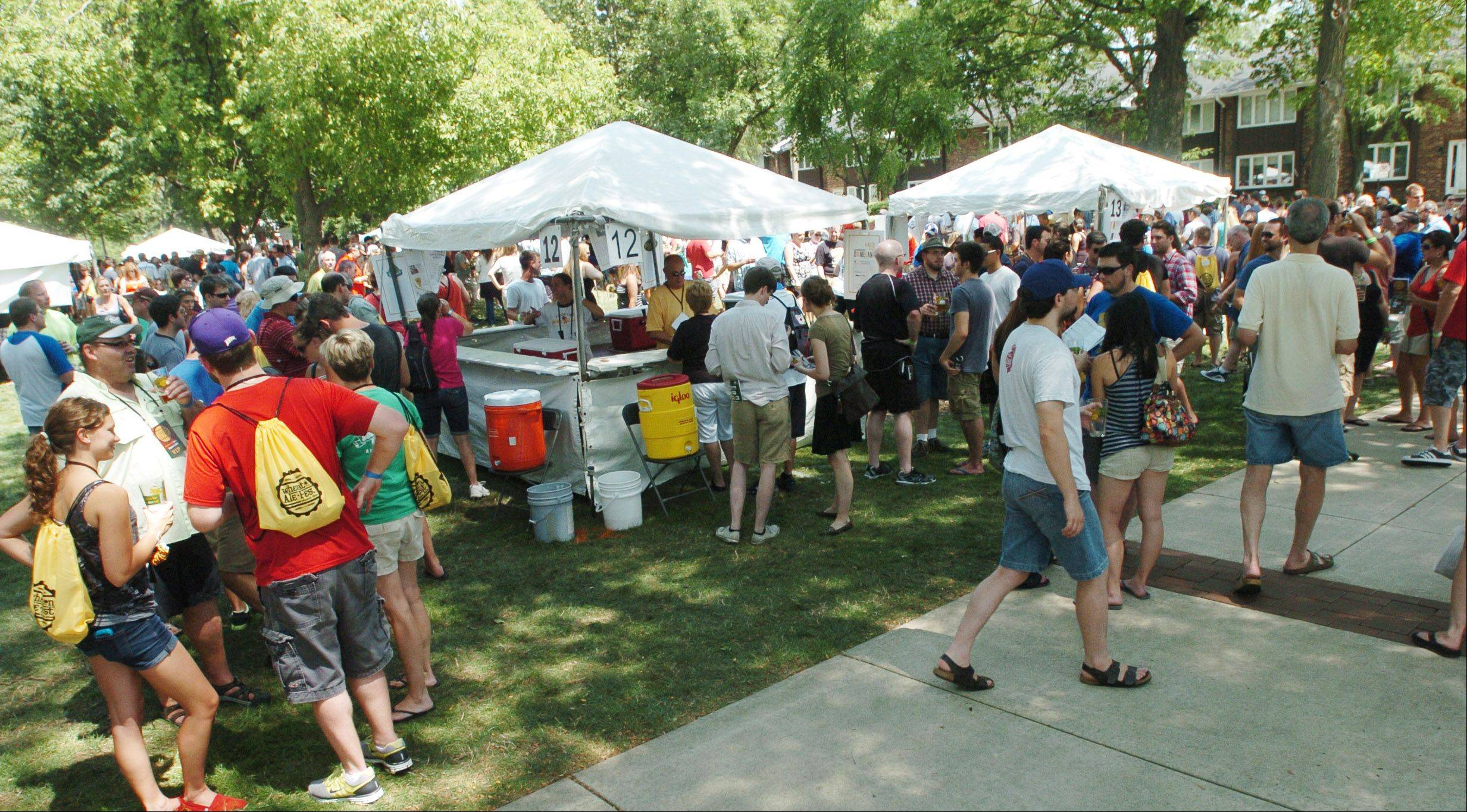 Beer lovers flock to the second annual Wheaton Ale Fest Saturday at Memorial Park. The event moved from its previous location on Front Street to the park for more space and shade.