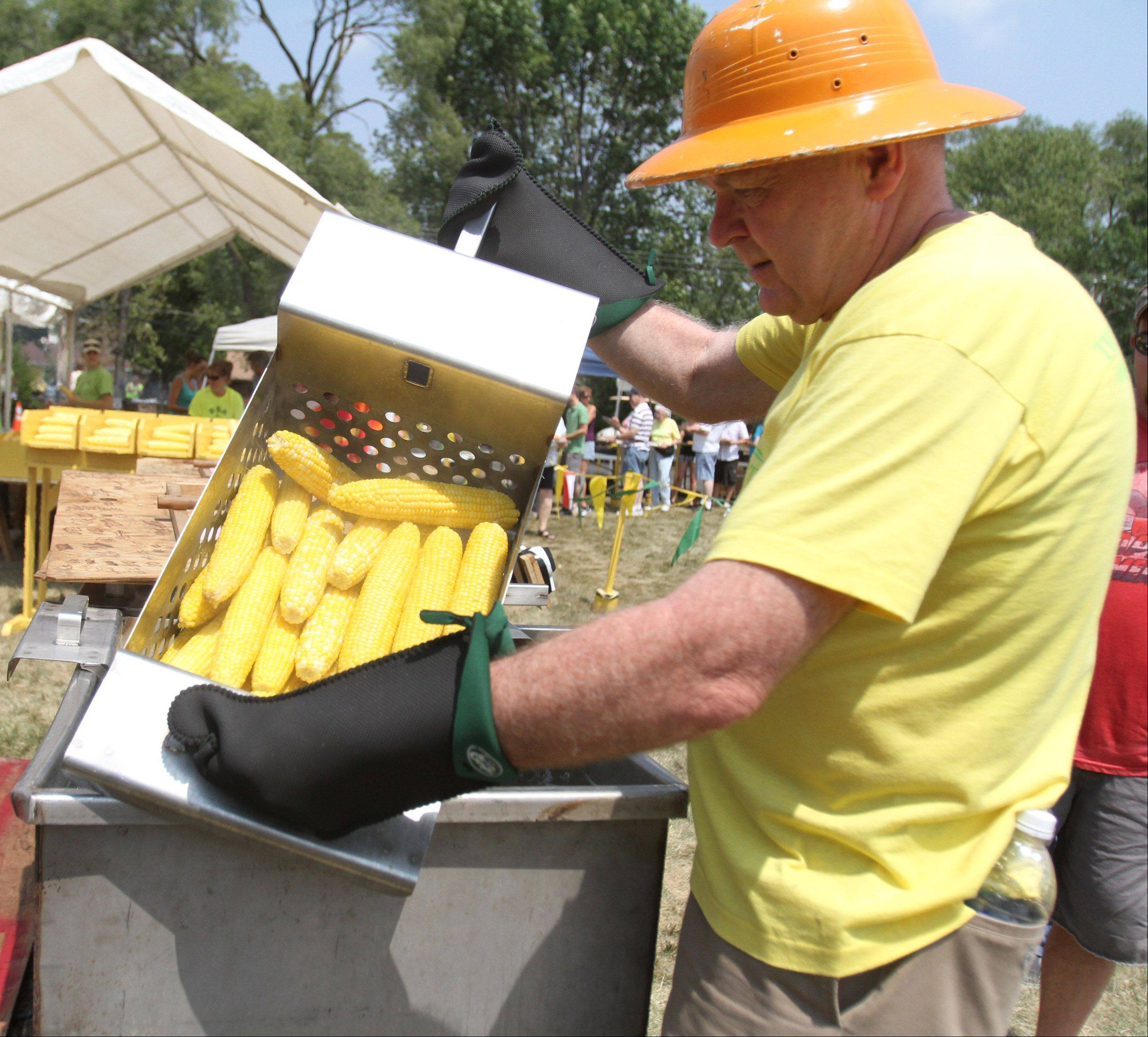 Richard Anderson of Rolling Meadows drains a batch of boiled ears of corn during Community Church of Rolling Meadows 56th Annual Cornfest on Saturday.