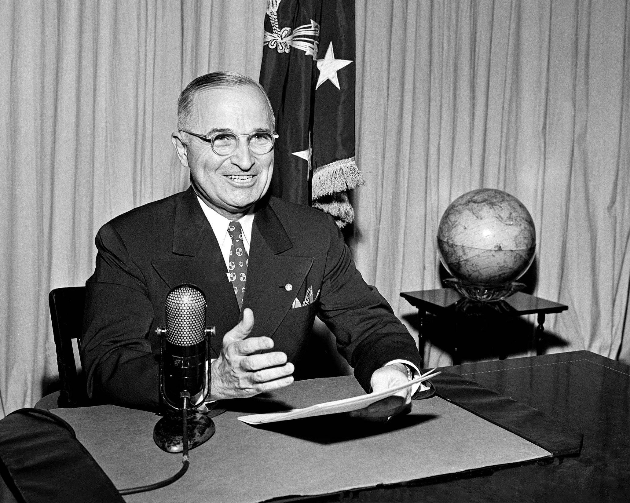 In this Sept. 1, 1945 file photo, then-U.S. President Harry Truman sits before a microphone at the White House in Washington, where he broadcast a message on the formal surrender of Japan. Clifton Truman Daniel, a grandson of ex-President Truman, who ordered the atomic bombings of Hiroshima and Nagasaki during World War II, is in Hiroshima to attend a memorial service for the victims on Monday, Aug. 6, 2012, marking the 67th anniversary of the atomic bombing.
