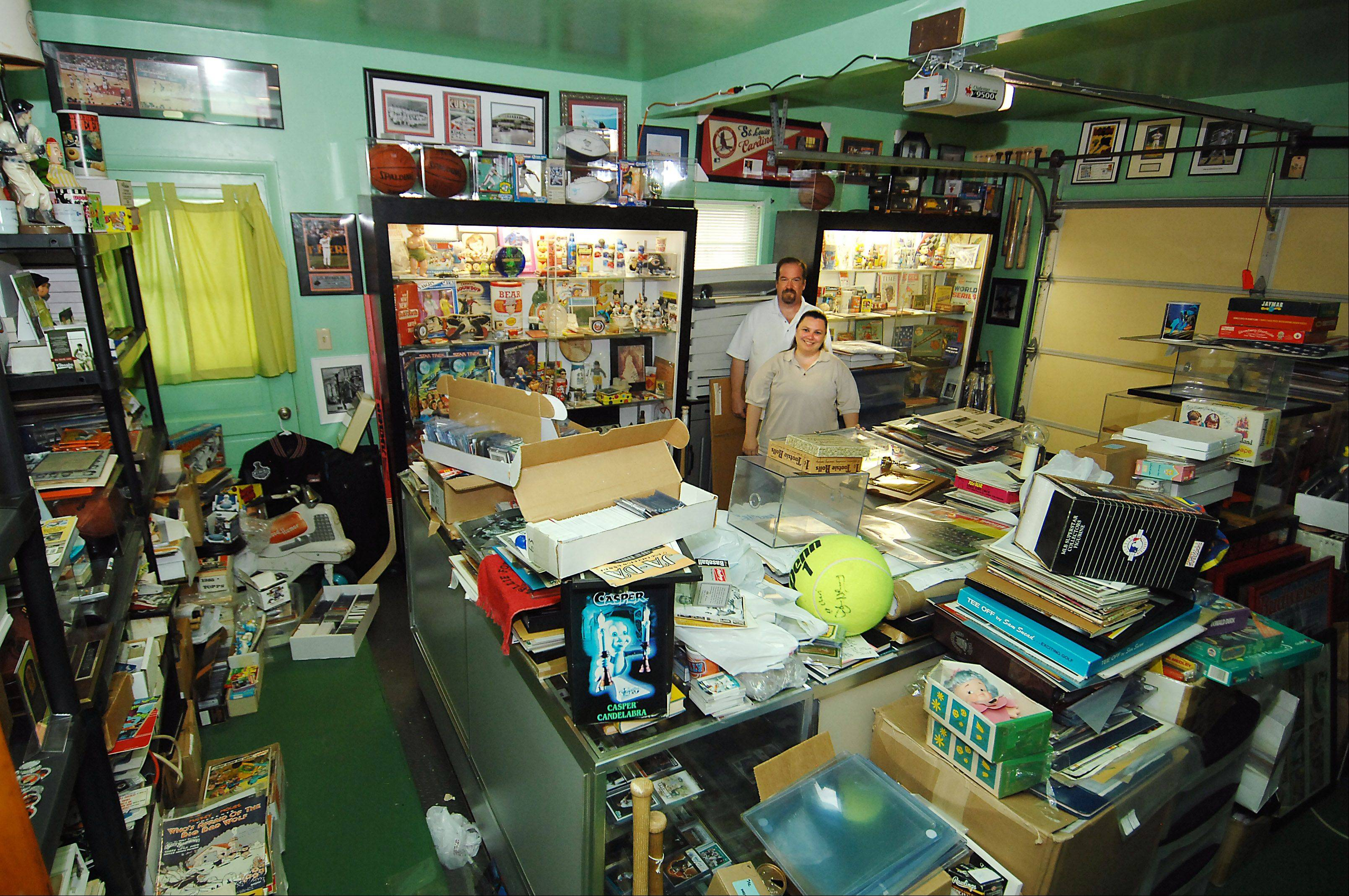 John and Debby Arcand estimate 4,500 square feet of their 5,400-square-foot home is filled with memorabilia and collectibles. The two have been collecting all sorts of items for close to 30 years.