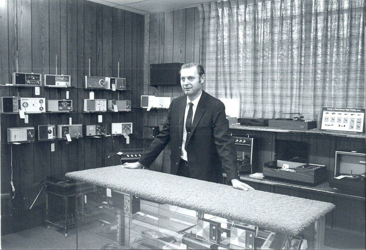 Ed Landwehr behind the counter of his new store, which provided nearly four times as much space as the original store on Dunton.