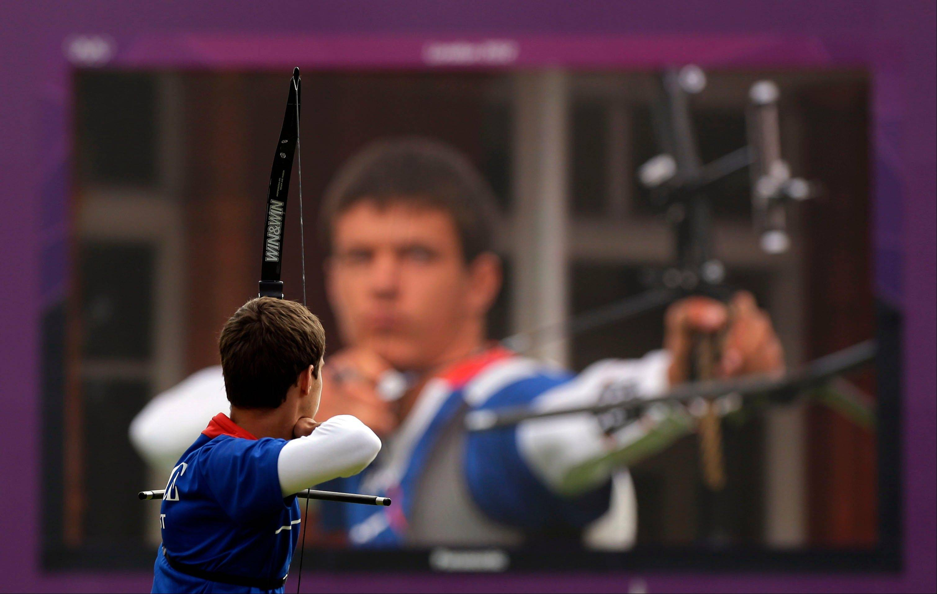 France's Gael Prevost shoots during the men's individual archery competition at the 2012 Summer Olympics, Friday, Aug. 3, 2012, in London.