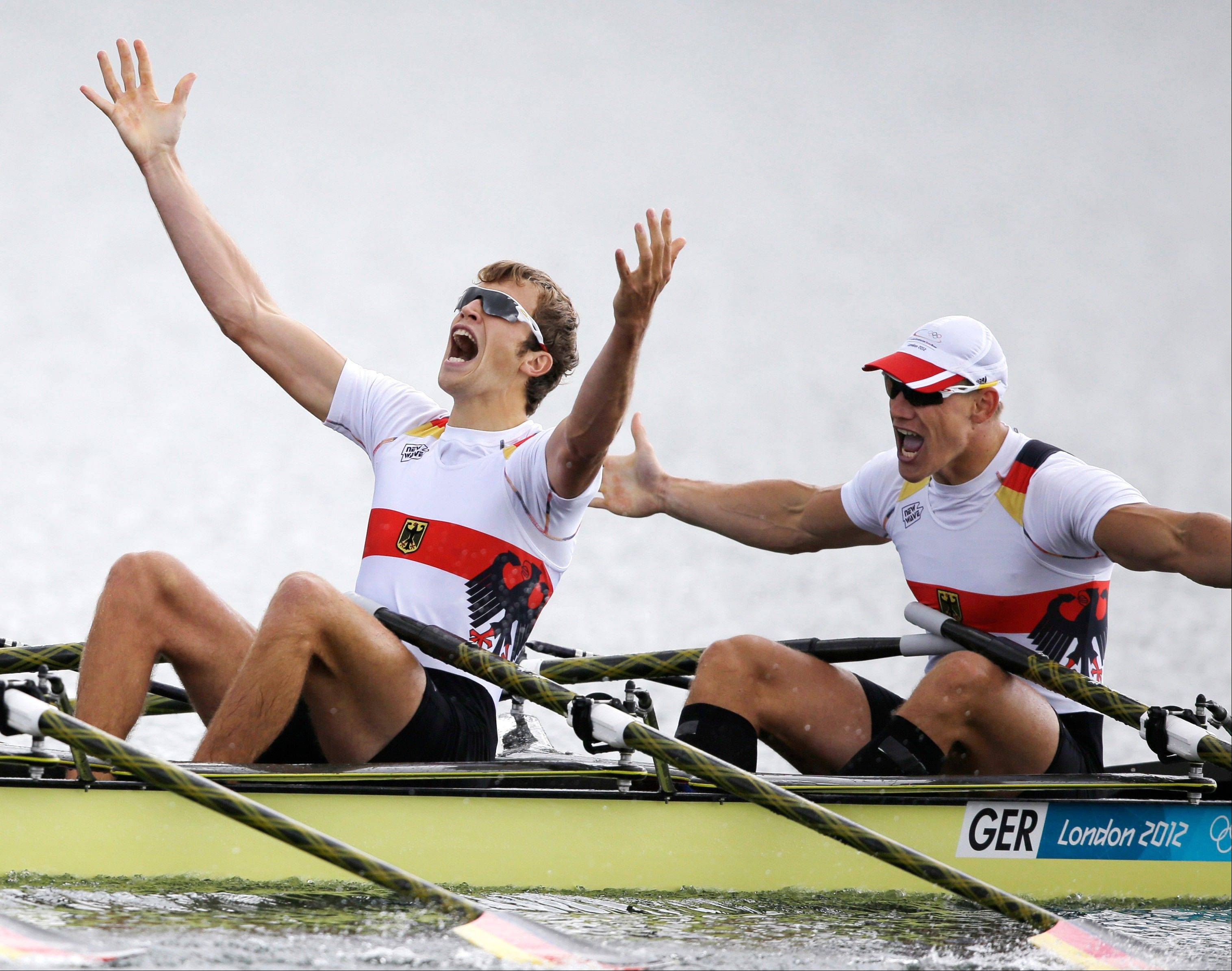 Germany's Phillipp Wende and Karl Schulze celebrate after winning the gold medal for the men's quadruple rowing sculls in Eton Dorney, near Windsor, England, at the 2012 Summer Olympics, Friday, Aug. 3, 2012.