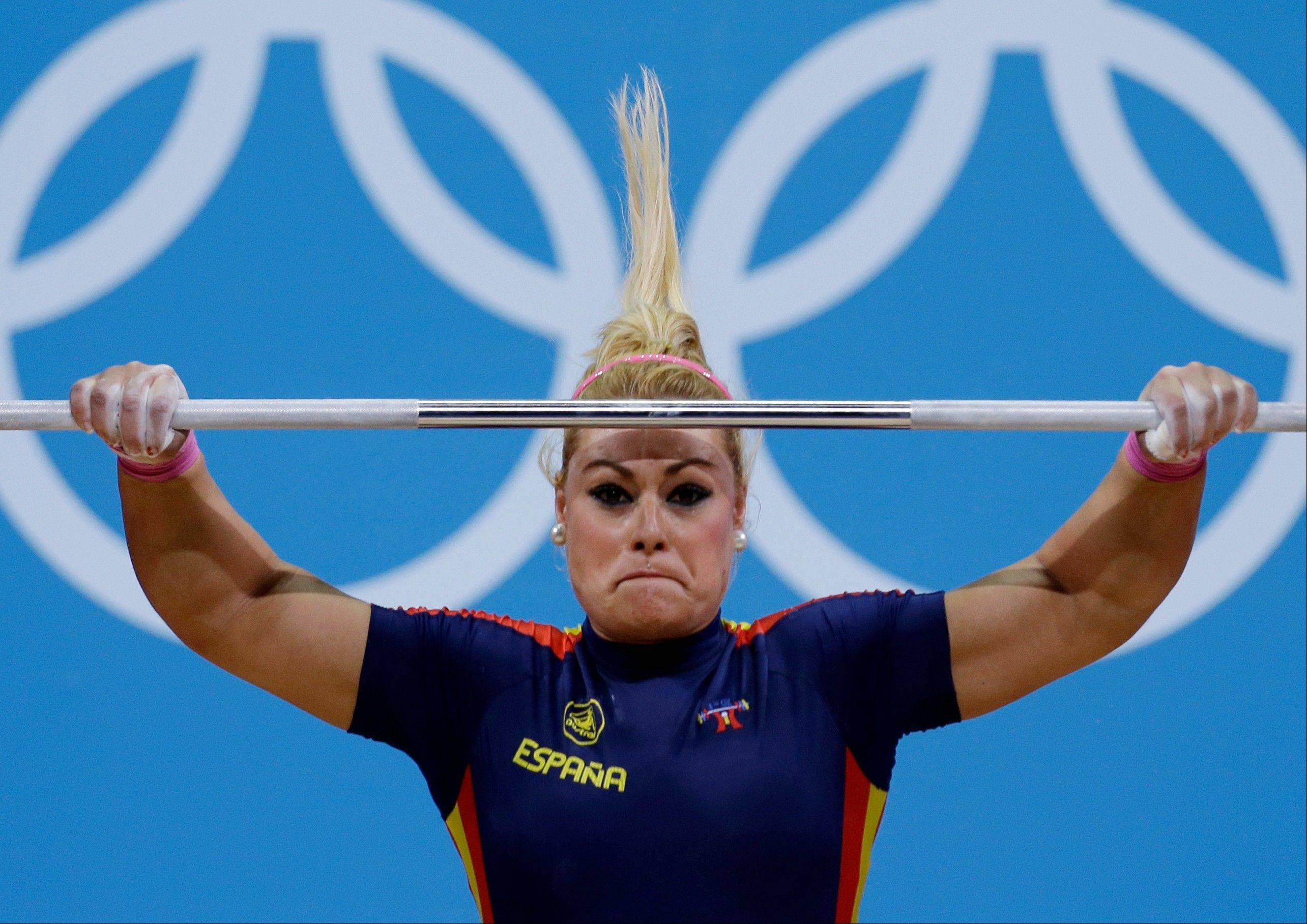 Lidia Valentin Perez of Spain competes during the women's 75-kg, group A, weightlifting competition at the 2012 Summer Olympics, Friday, Aug. 3, 2012, in London.