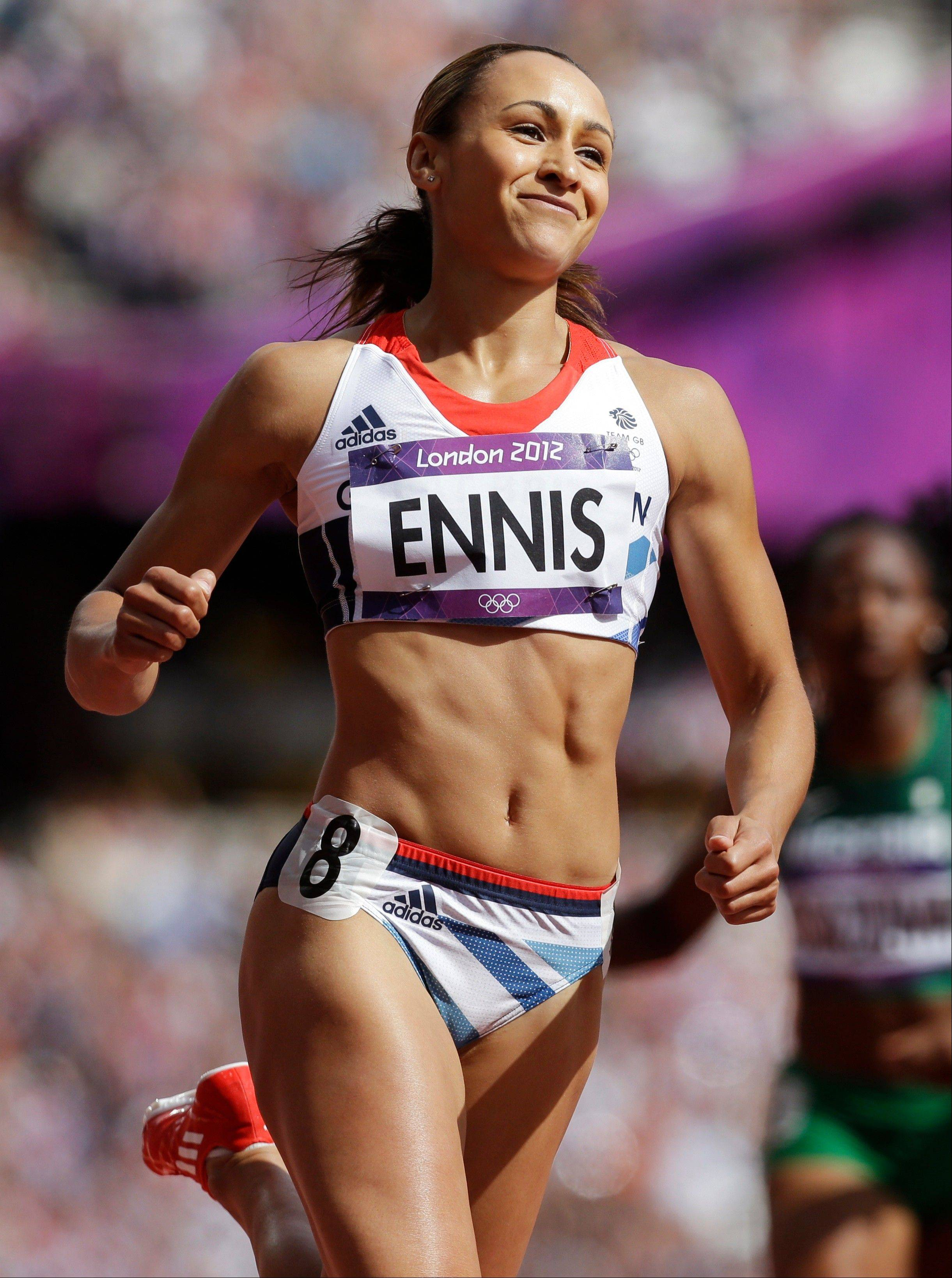 Britain's Jessica Ennis smiles after winning her 100-meter hurdles heat of the Women's Heptathlon during the athletics in the Olympic Stadium at the 2012 Summer Olympics, London, Friday, Aug. 3, 2012.