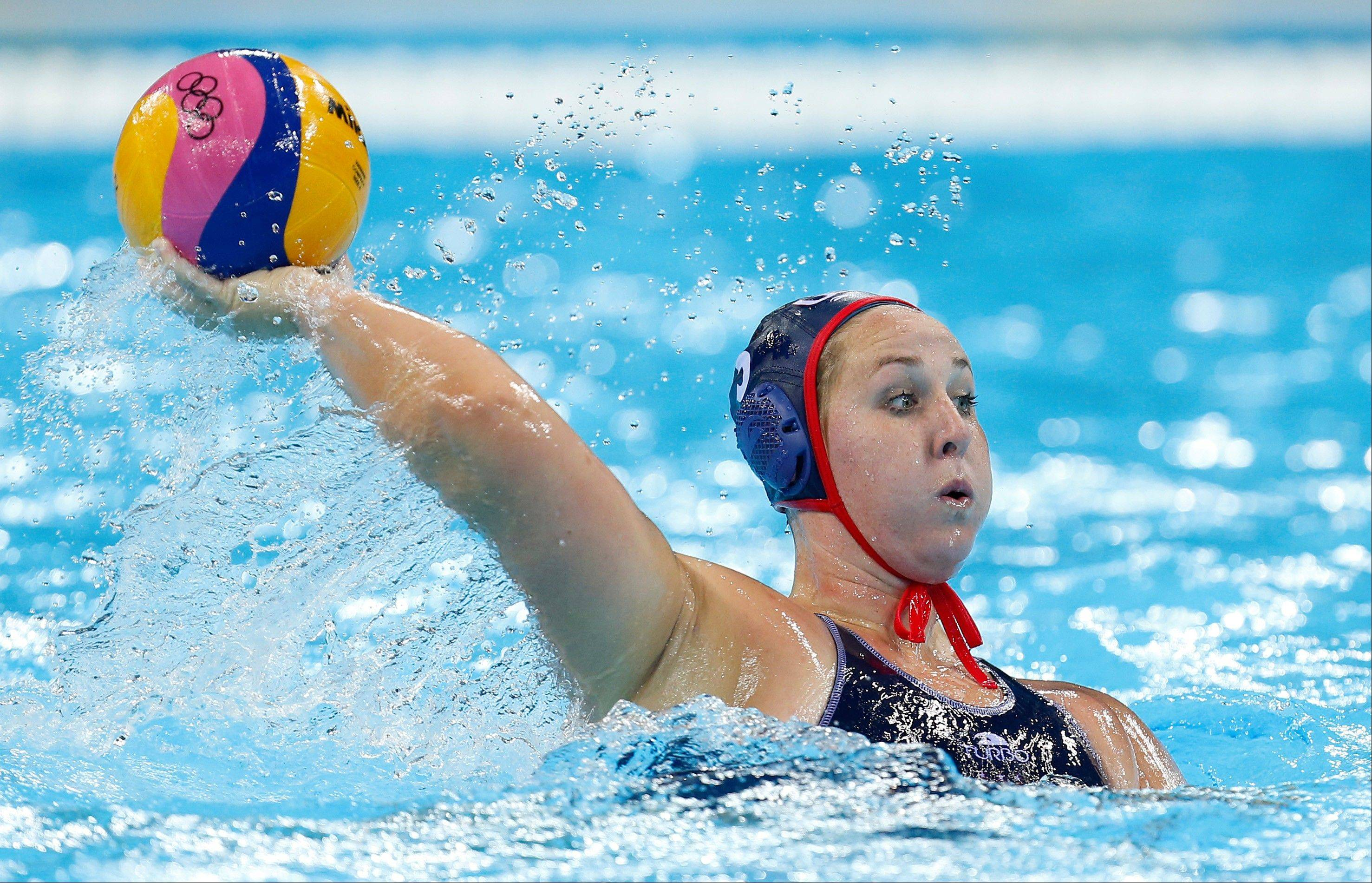 Melissa Seidemann of the United States\takes a shot at goal during their women's water polo preliminary round match against China at the 2012 Summer Olympics, Friday, Aug. 3, 2012, in London.