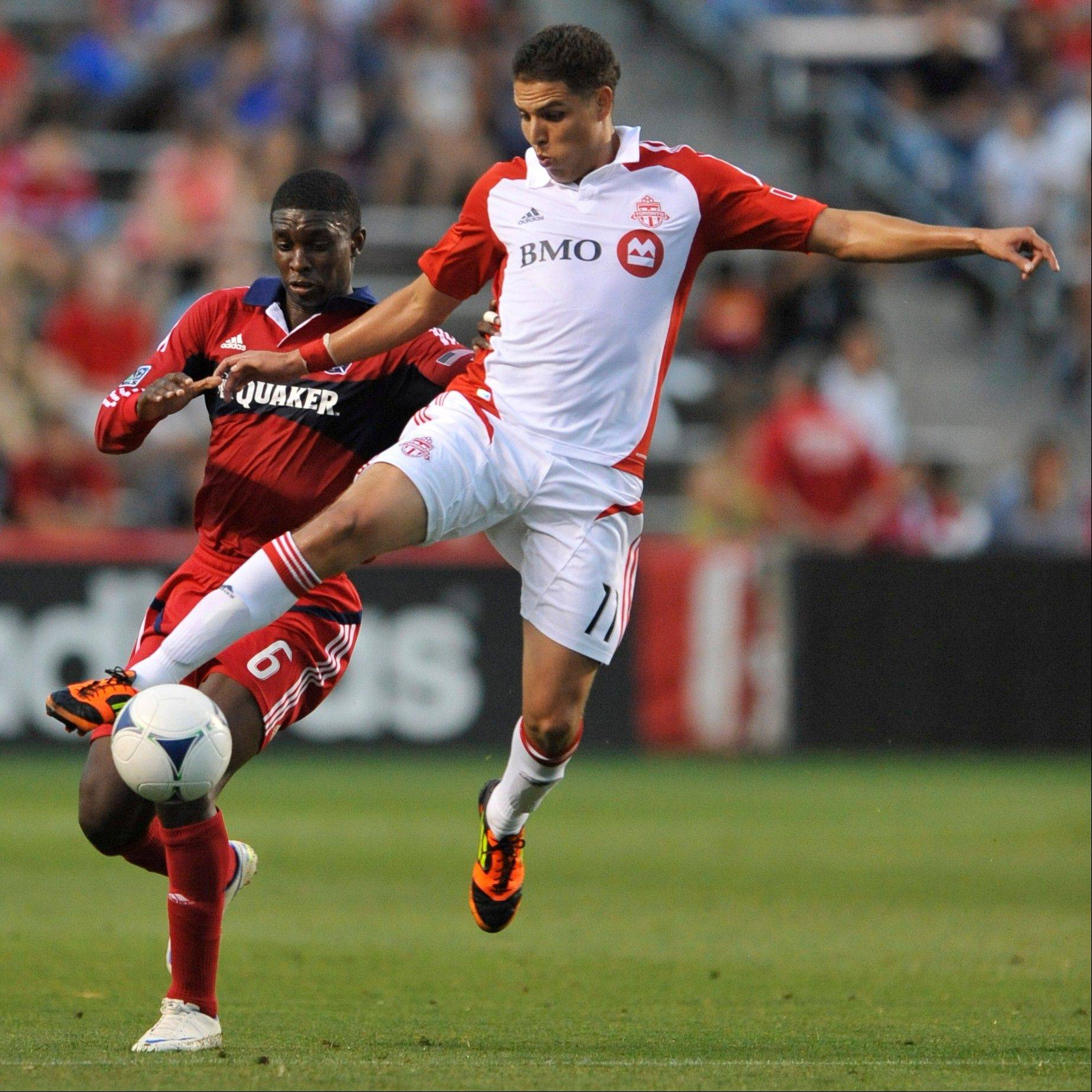 Toronto FC's Luis Silva works against the Fire's Jalil Anibaba for the ball in the first half Saturday night at Toyota Park.