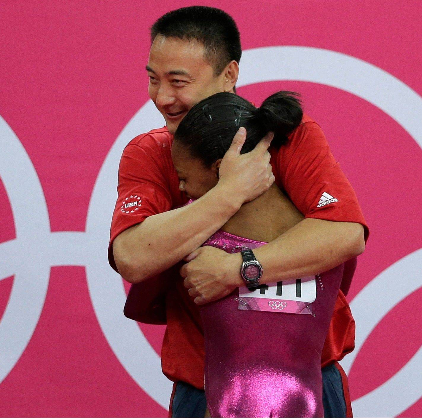 "Gymnastics all-around gold medalist Gabby Douglas receives congratulations from coach Liang Chow, who said, ""She was sacrificing being with her mom in order to be the best gymnast she can be. That touched my heart."""