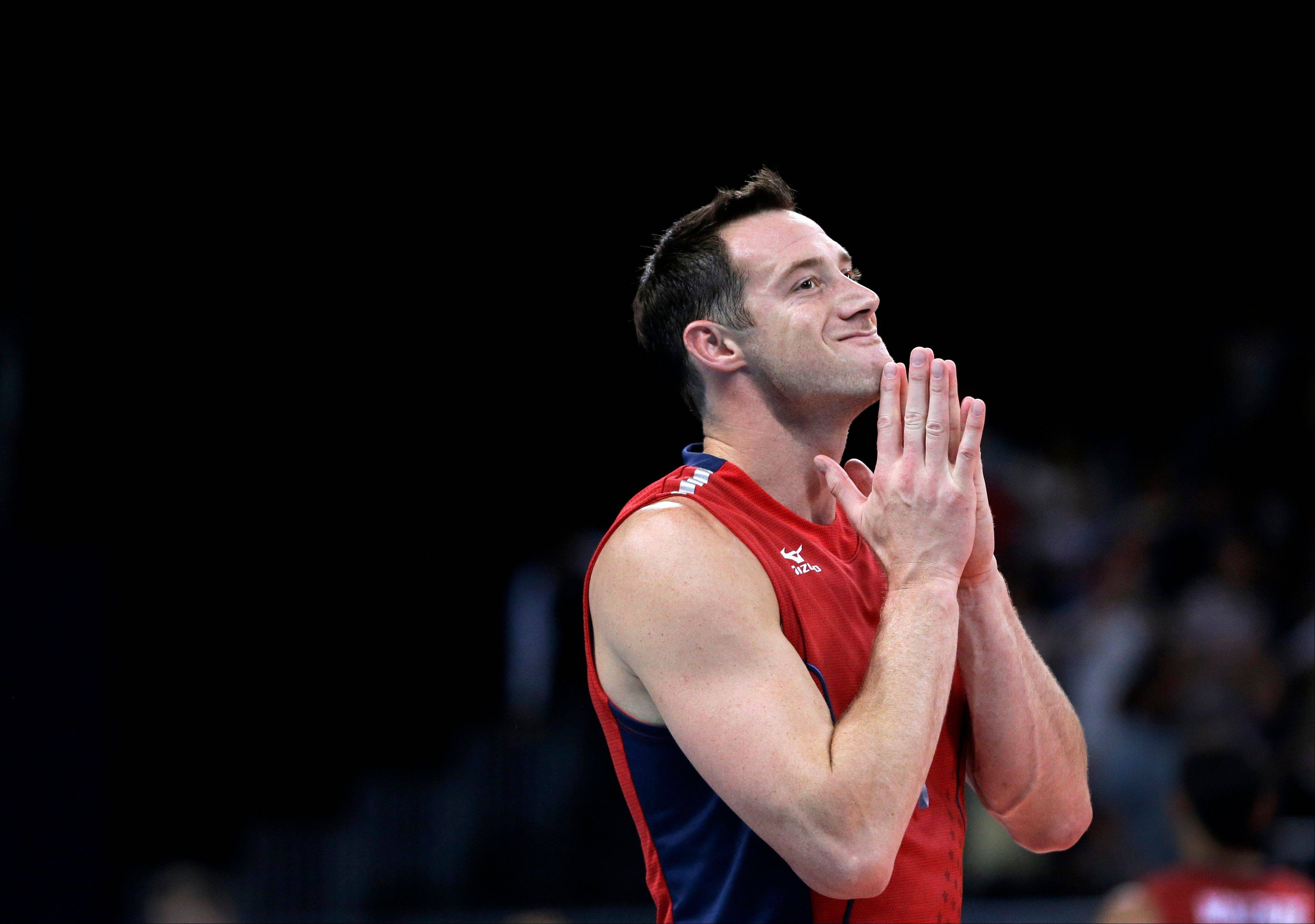 The United States' David Lee reacts Saturday following his team's defeat by Russia in a men's preliminary volleyball match at the 2012 Summer Olympics.