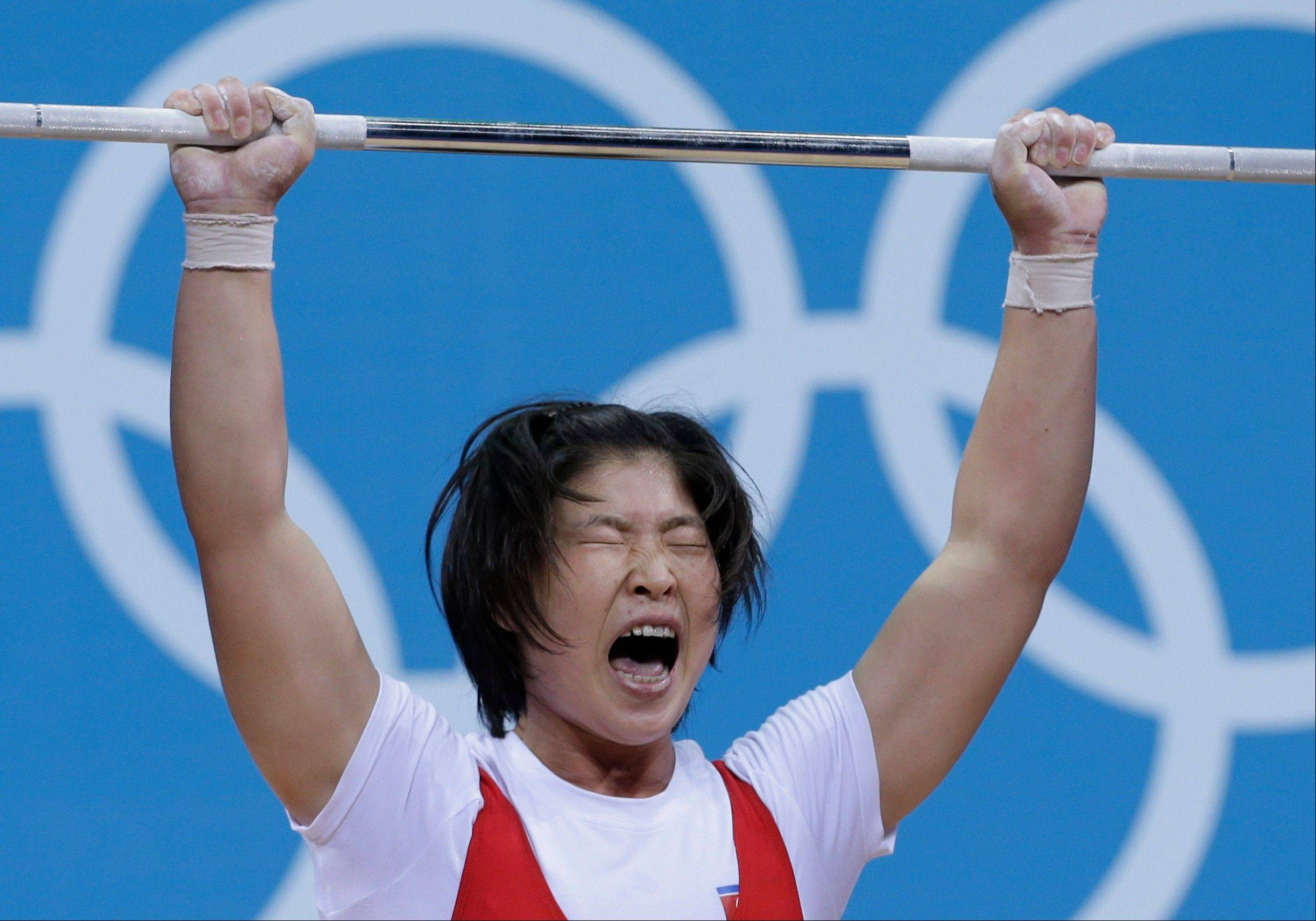 North Korea's Rim Jong Sim competes during the women's 69-kg, group A, weightlifting competition at the 2012 Summer Olympics on Aug. 1. Check out heavyweight women's weightlifting Sunday, while most people are watching Jamaica's Usain Bolt in the men's 100-meter final.