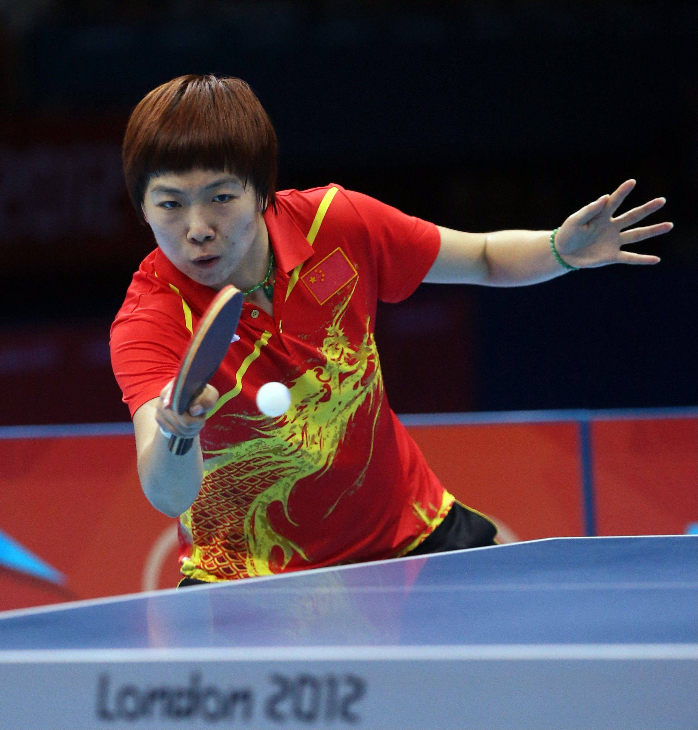 China's Li Xiaoxia takes a shot in a women's gold medal table tennis match against China's Ding Ning at the 2012 Summer Olympics on Aug. 1. Women's team table tennis wraps up Tuesday, and the Chinese are heavily favored.