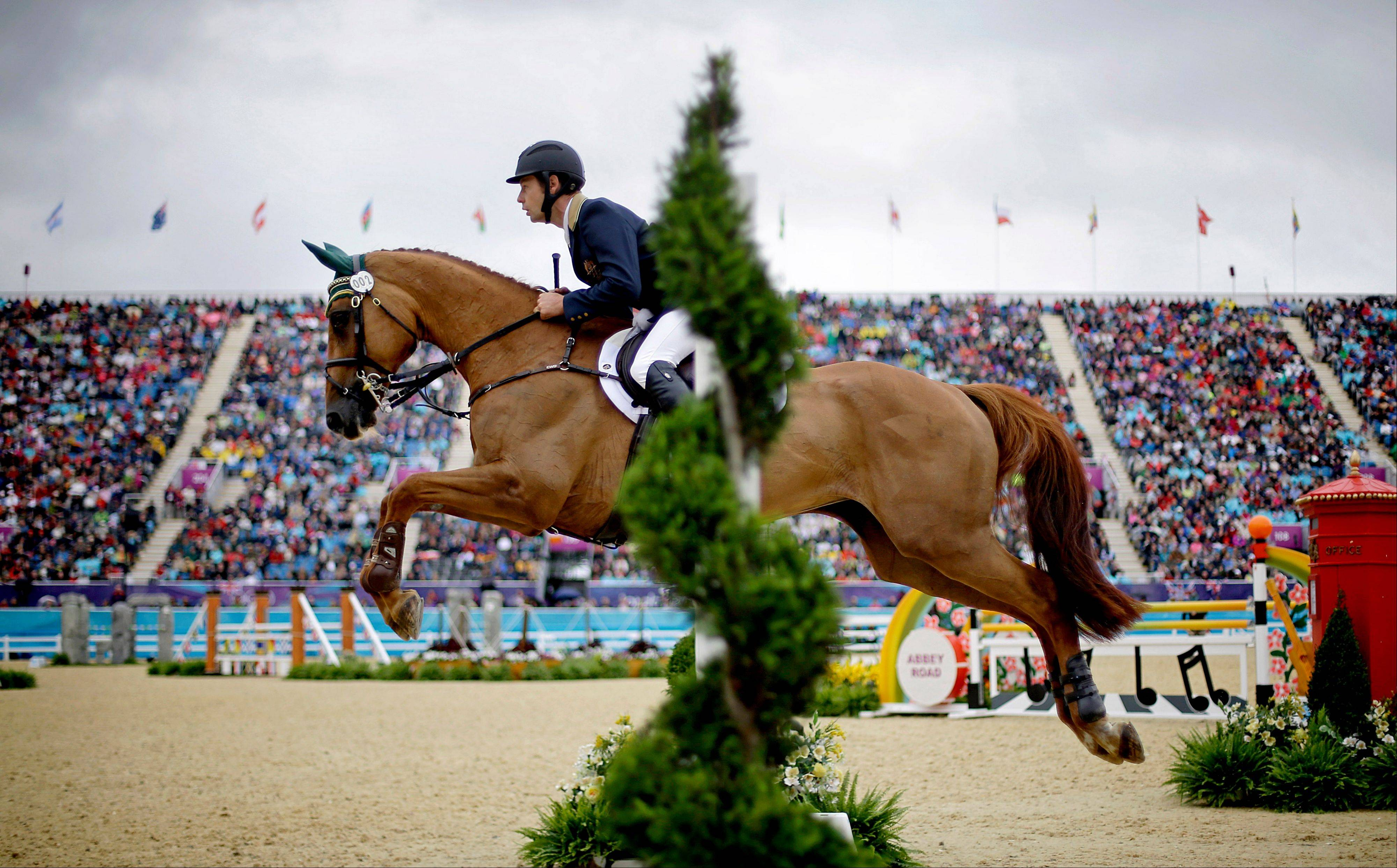 Australia's Christopher Burton and his horse HP Leilani, clear a jump in the equestrian individual show jumping at the 2012 Summer Olympics on July 31. You can see the finals of equestrian's individual jumping event Wednesday, while everyone else is watching women's beach volleyball.