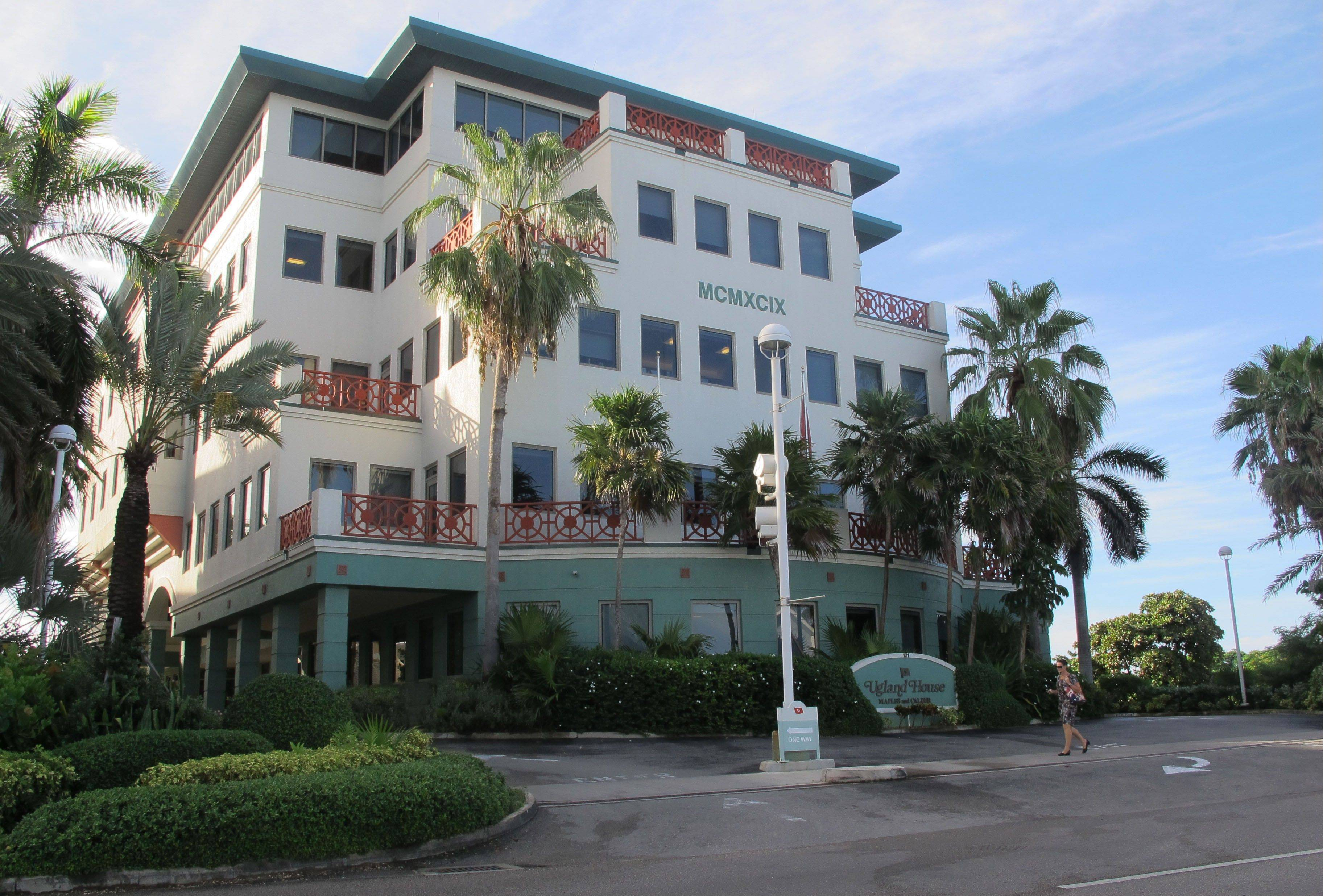 The Ugland House, the registered office for thousands of global companies, stands in George Town on Grand Cayman Island. The Cayman Islands have lost some of their allure by abruptly proposing what amounts to an income tax on expatriate workers.
