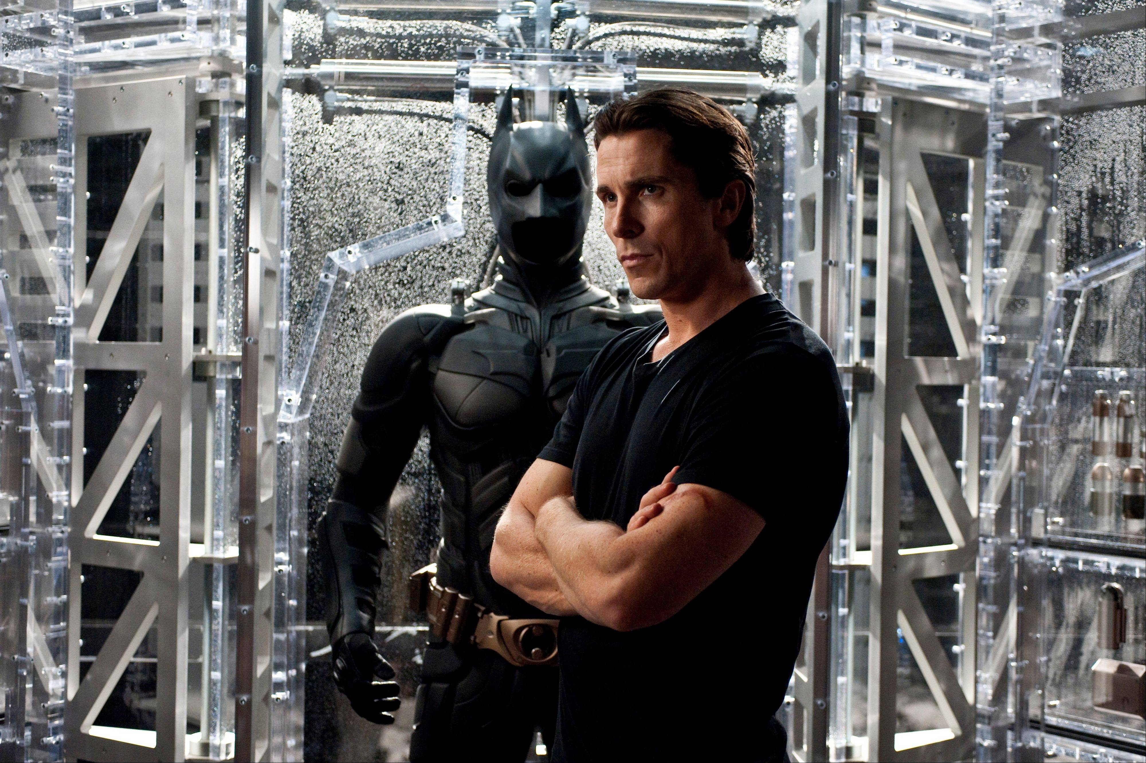 "In this film image released by Warner Bros., Christian Bale portrays Bruce Wayne and Batman in a scene from ""The Dark Knight Rises,"" which has kept its hold on the box office for three weeks."