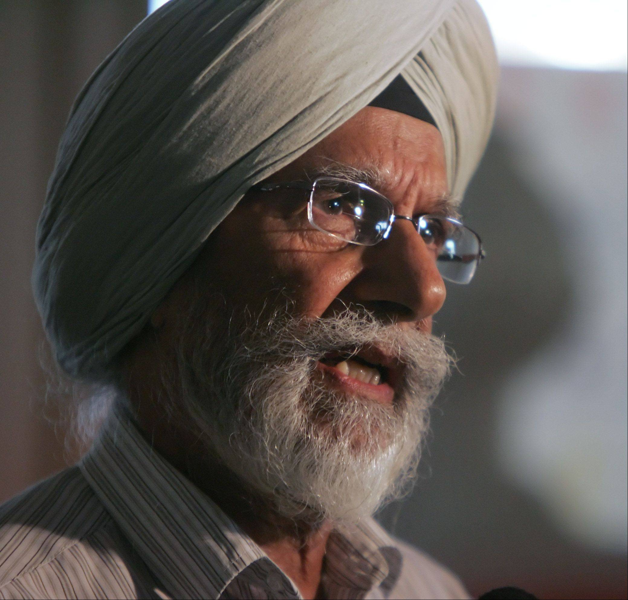 Balwant Singh Hansra, a member of the Gurudawara Sikh Religious Society in Palatine, discusses the shooting at a Sikh temple near Milwaukee Sunday.