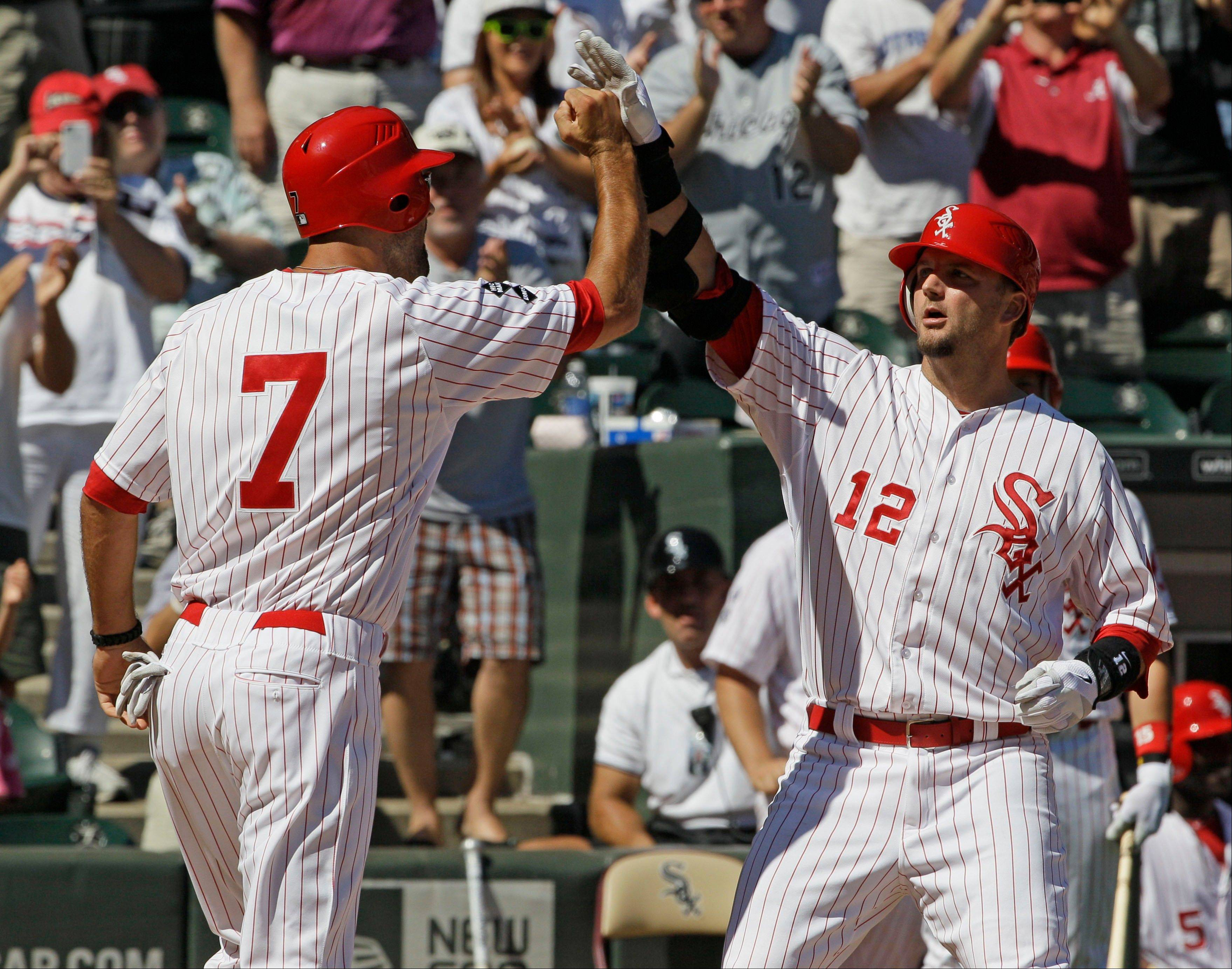 A.J. Pierzynski, right, celebrates with Jordan Danks after hitting a 2-run home run against the Los Angeles Angels during the seventh inning Sunday at U.S. Cellular Field.