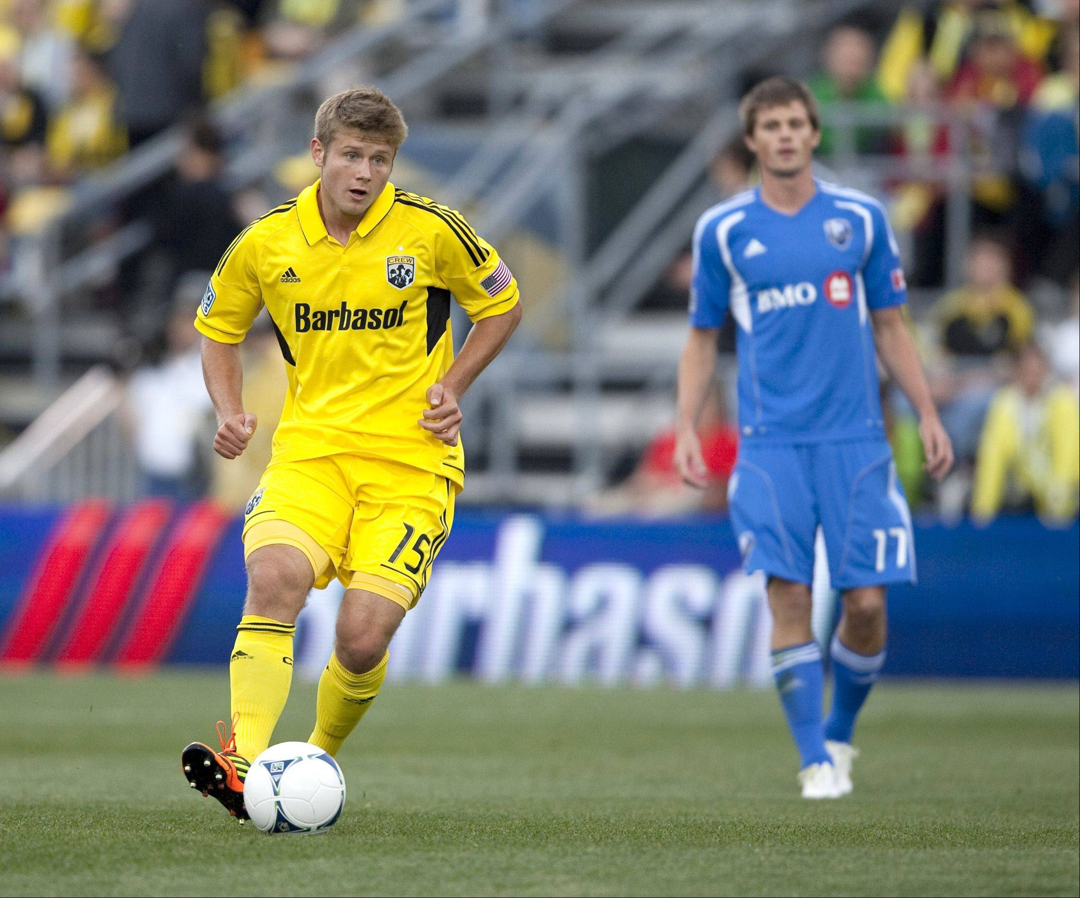 Columbus Crew midfielder Kirk Urso (15) handles the ball against the Montreal Impact for the opening game of the season at Crew Stadium in Columbus on March 24. Urso died Sunday after he was found unconscious in a bar.