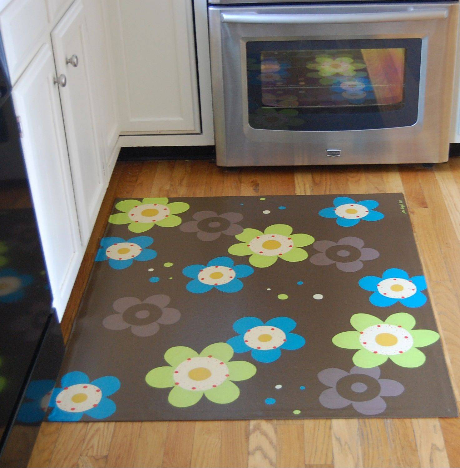 A floorcloth by Julie Biggs that incorporates modern colors and design.