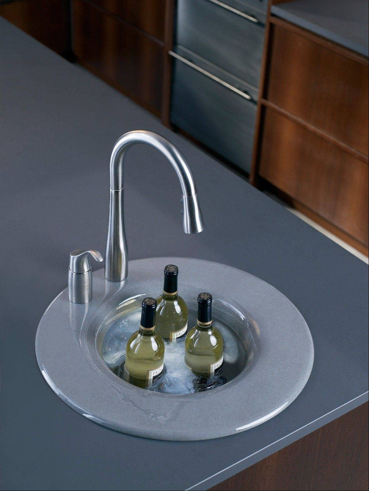 Because of its versatility and vibrant color possibilities, enameled cast iron is fast becoming the material of choice among those wanting to install high-end bar sinks.
