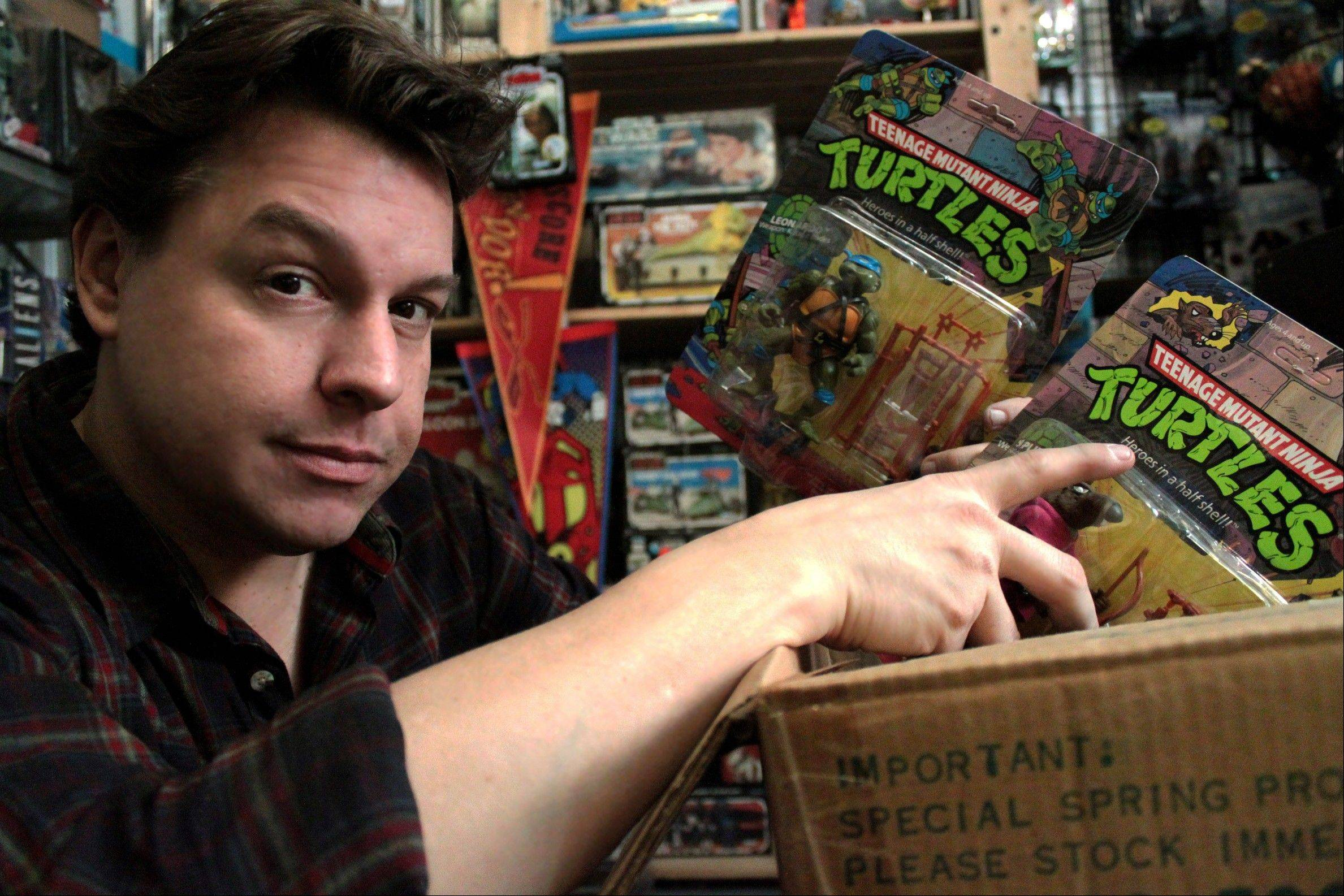 "In this publicity image provided by the Travel Channel, toy hunter Jordan Hembrough unpacks a box of the original ""Heroes on the Half Shell"" from Teenage Mutant Ninja Turtles. ""Toy Hunter"" premieres on the Travel Channel on Aug. 15."