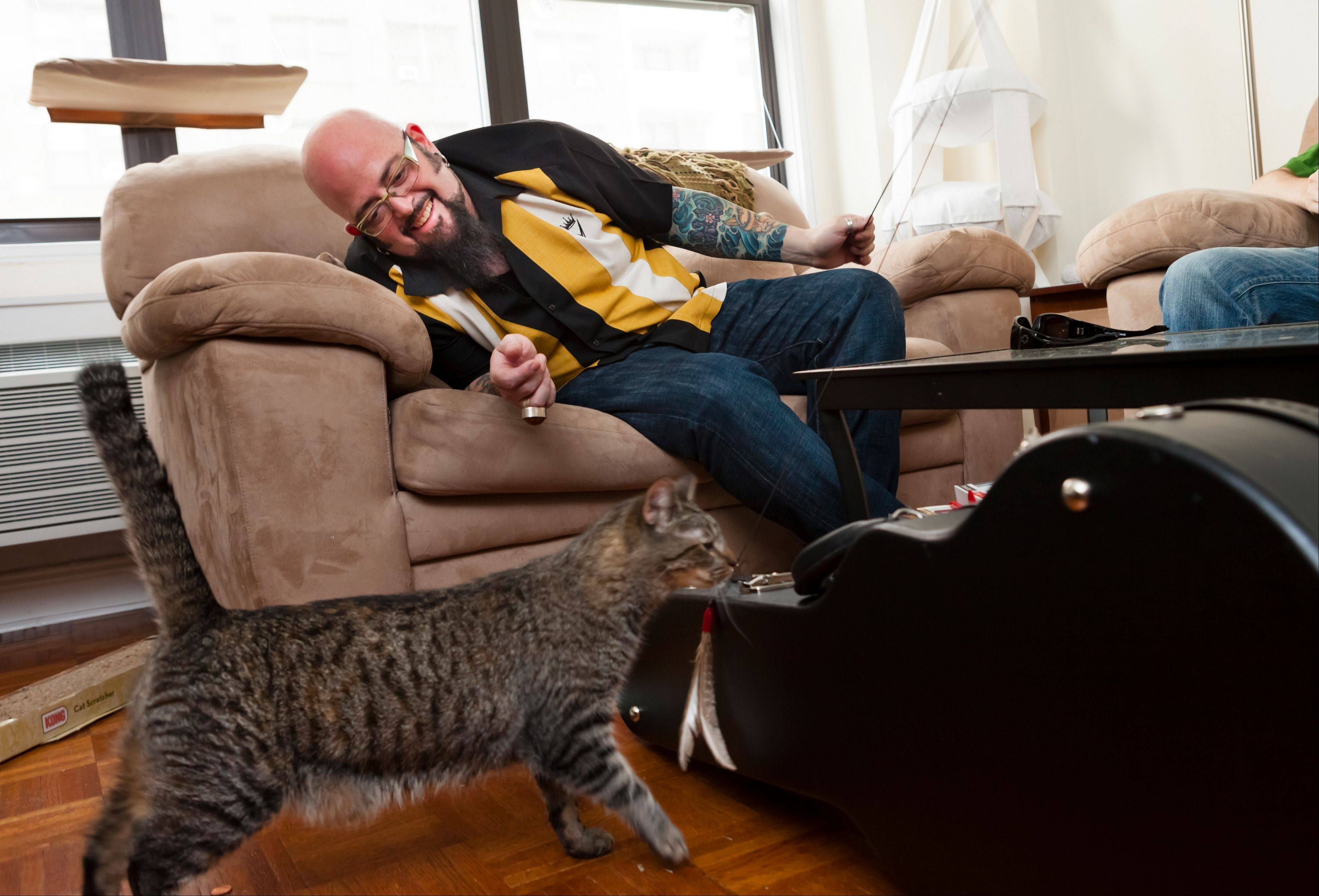 "Cat behaviorist Jackson Galaxy is shown in May 2012 working with Oliver the cat, during production of Season 3 of Animal Planet's ""My Cat From Hell"" in New York. On his TV show, Galaxy helps cats and cat owners solve behavior problems, human and feline."