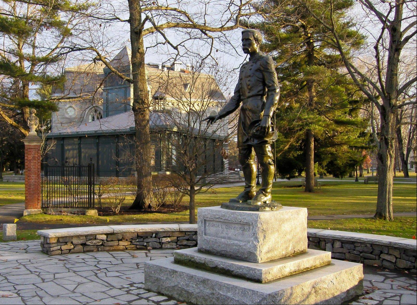 A statue of Joshua Chamberlain in Brunswick, Maine, is located on the grounds of the Bowdoin College campus. Chamberlain, a graduate of Bowdoin College and a professor there, led the Union's defense of Little Round Top at the Battle of Gettysburg during the Civil War and accepted the Confederacy's surrender at Appomattox in Virginia in 1865.