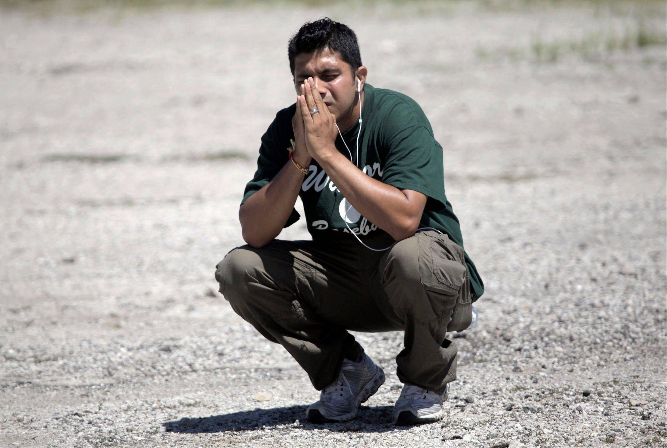 A family member waits to hear information about his loved ones inside the Sikh temple in Oak Creek, Wis., on Sunday.