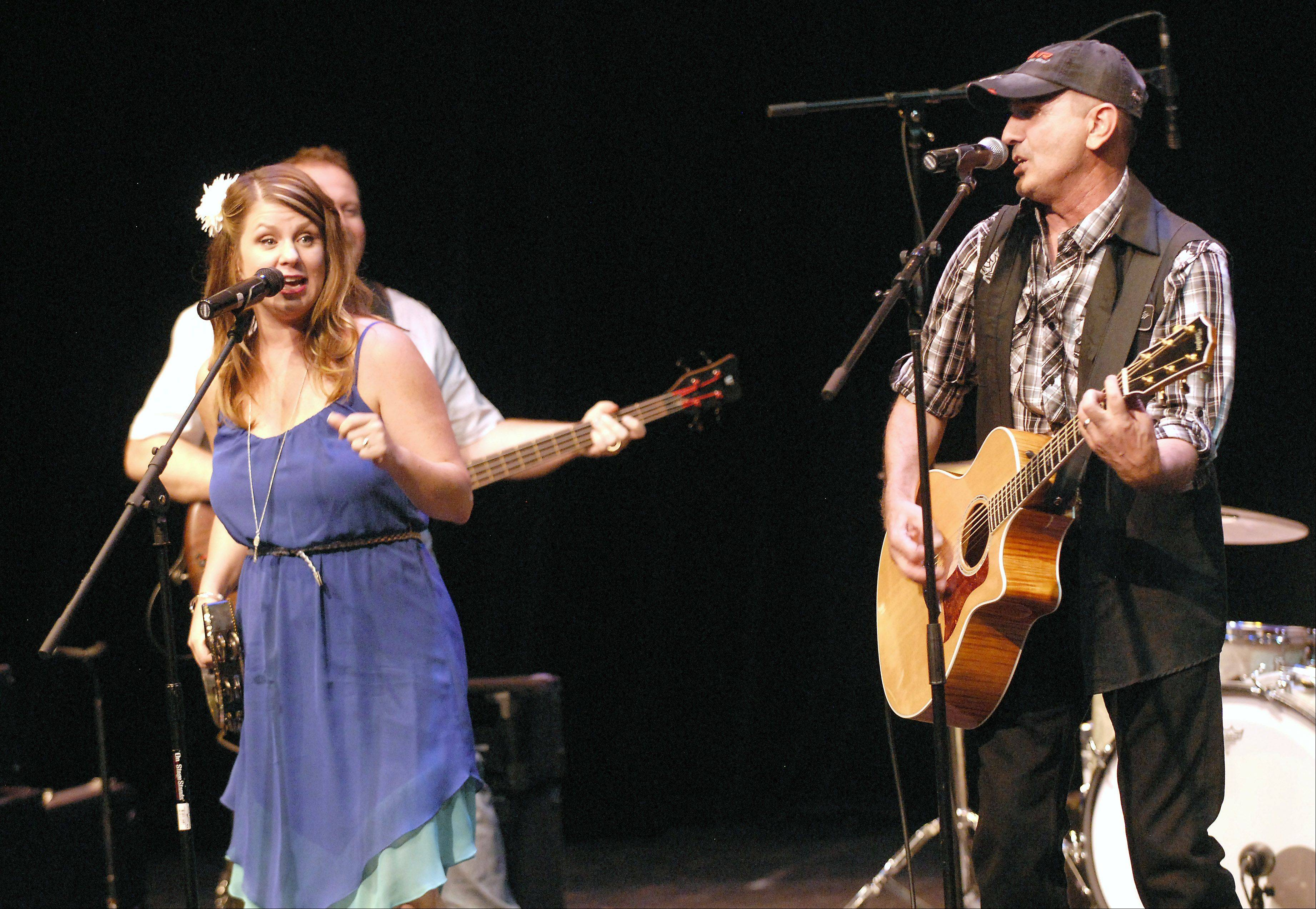 Faith and Whiskey featuring Camille Eiseman, 41, and Terry Tank, 50, both of Crystal Lake, perform as one of the final five finalists of Suburban Chicago's Got Talent for the judges and a ticketed crowd at the Metropolis Performing Arts Centre Sunday in Arlington Heights.