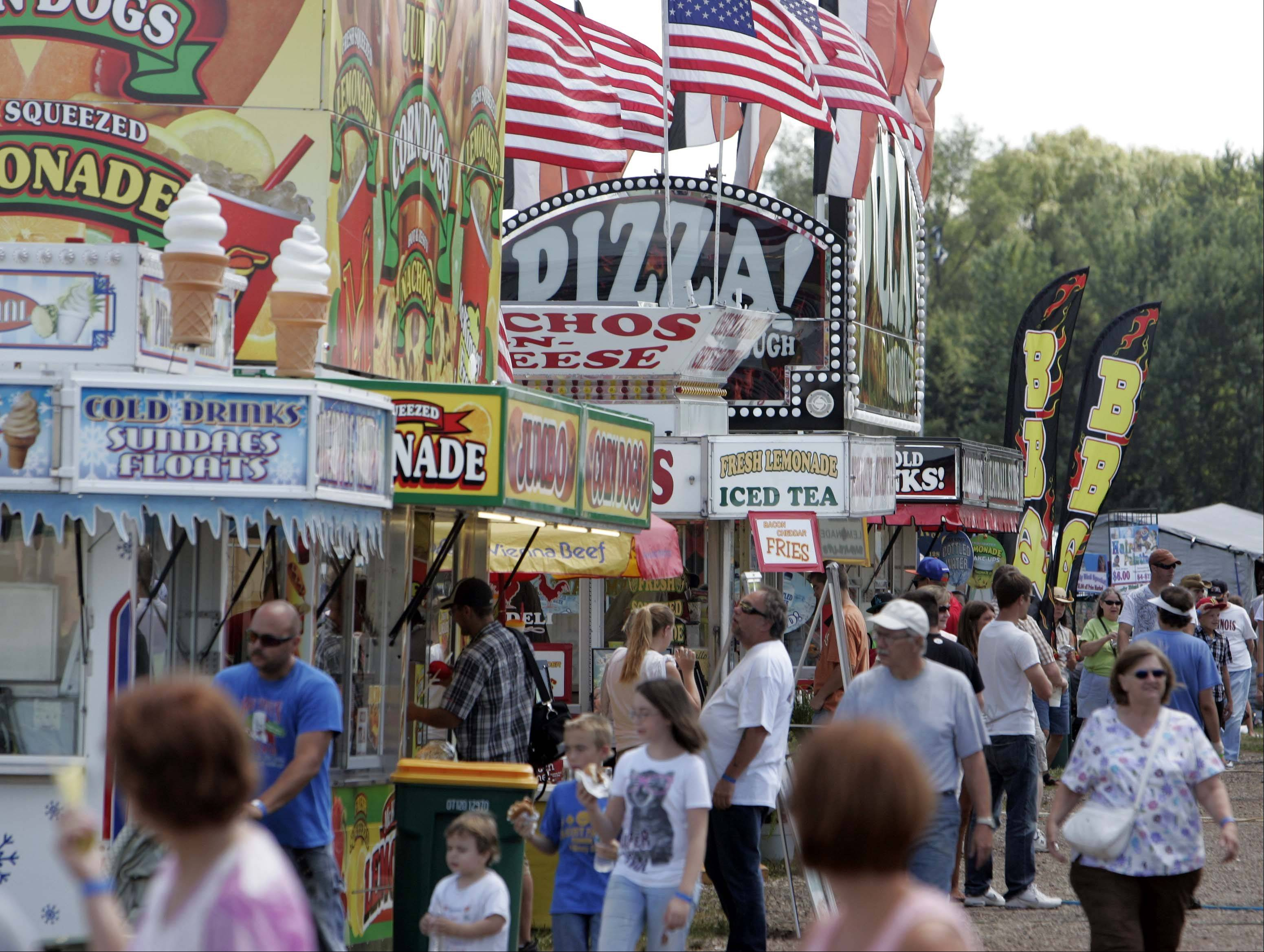 The food booths at the McHenry County Fair are lined with people Sunday.