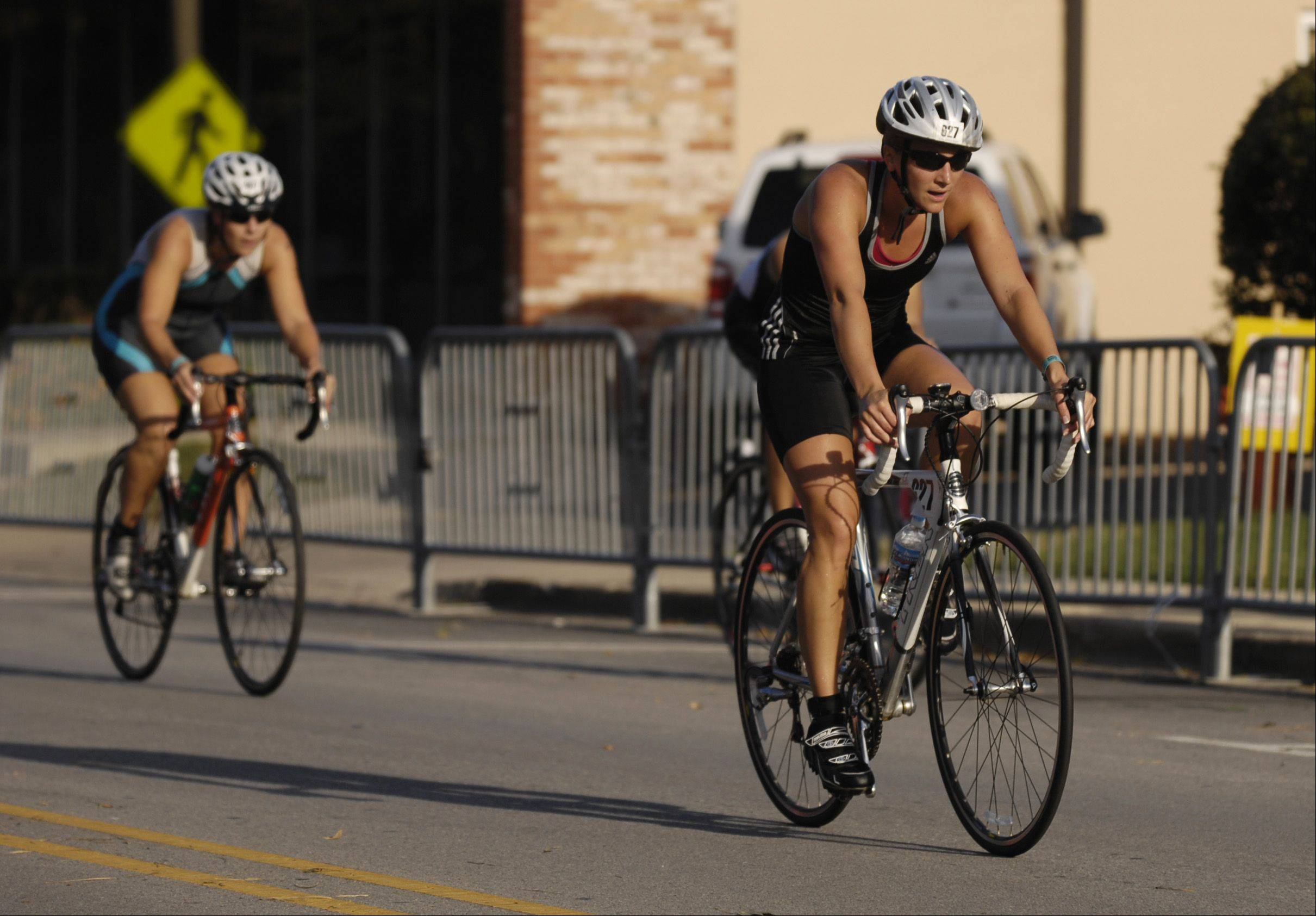 Racers head out on the course for the biking portion of the 2012 Naperville Sprint Triathlon at Centennial Beach Sunday.