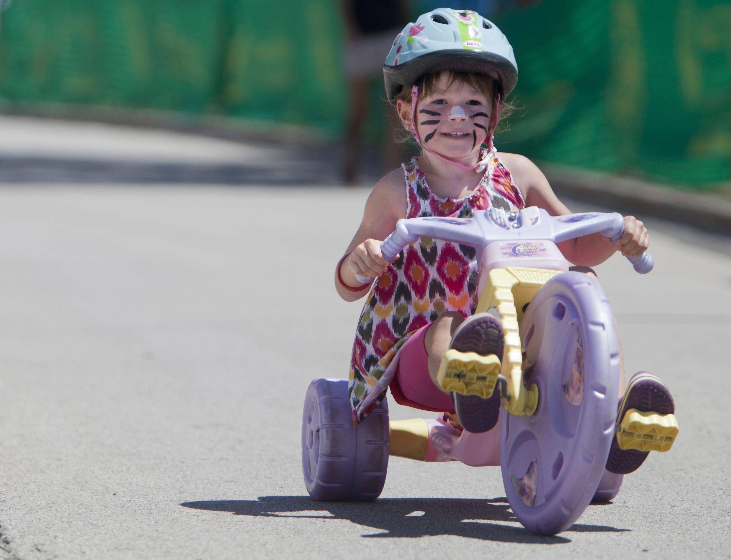 "Emily Kleinfeldt, 5, of Elk Grove rides her tricycle during Shamino ""Big Wheels"" during the third day of the Tour of Elk Grove."