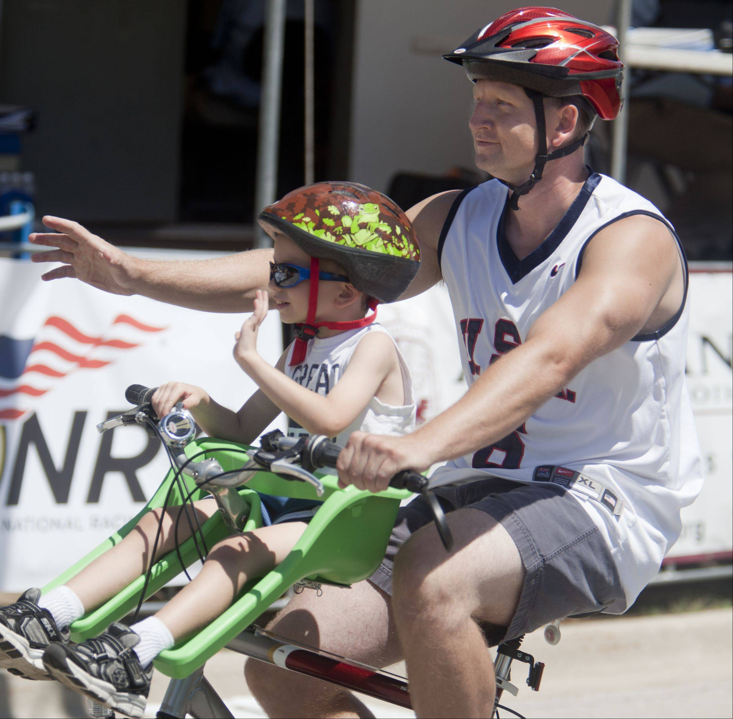 David Brand and his son Nolan, 4, cross the finish line during the Elk Grove Trustee fun run at the third day of the Tour of Elk Grove.
