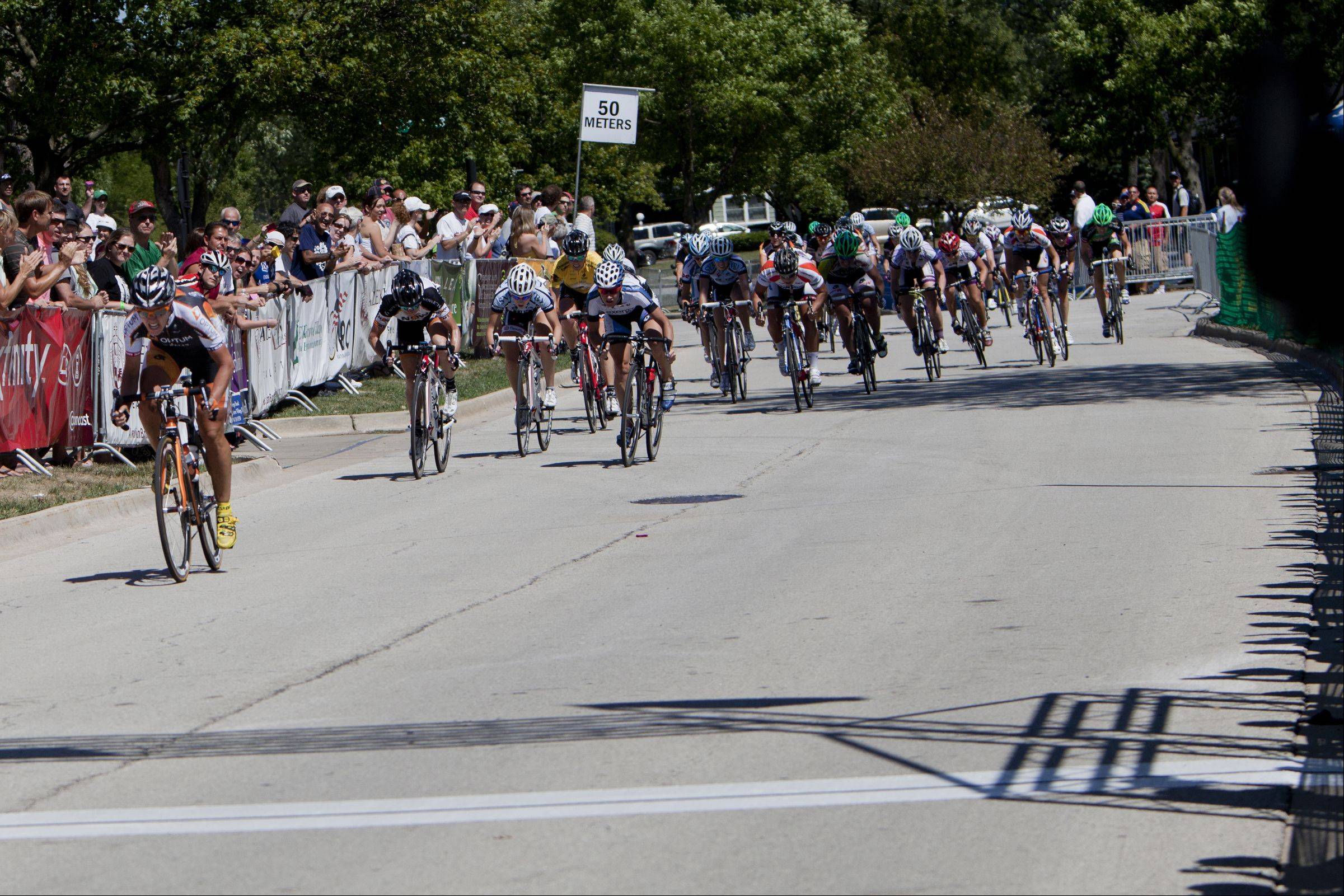 Jade Wilcoxson crosses the finish line to place first overall during the third day of the Alexian Brothers Tour of Elk Grove Union Cycliste Internationale.