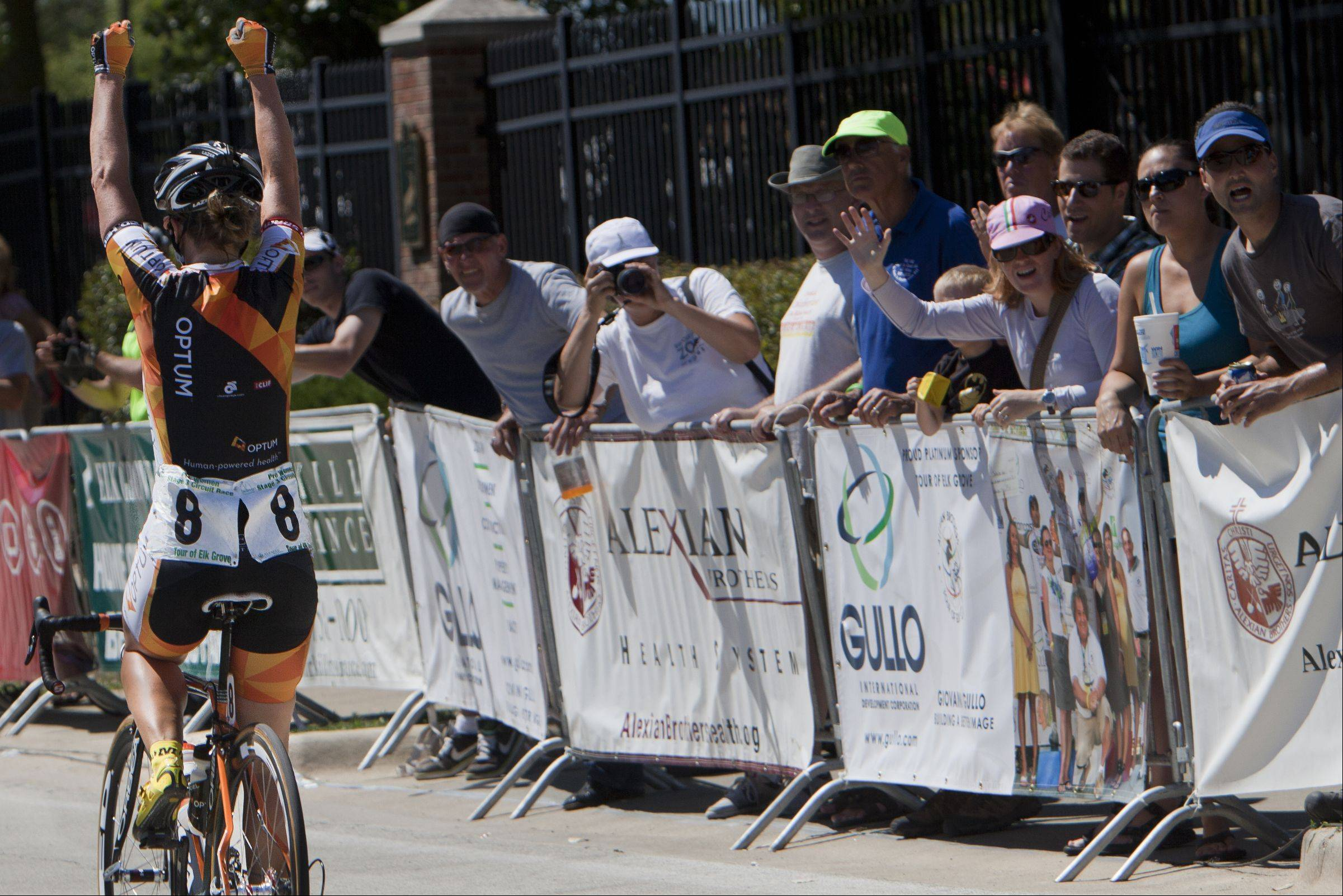 Jade Wilcoxson raises her arms after crossing the finish line to place first overall during the third day of the Alexian Brothers Tour of Elk Grove Union Cycliste International.