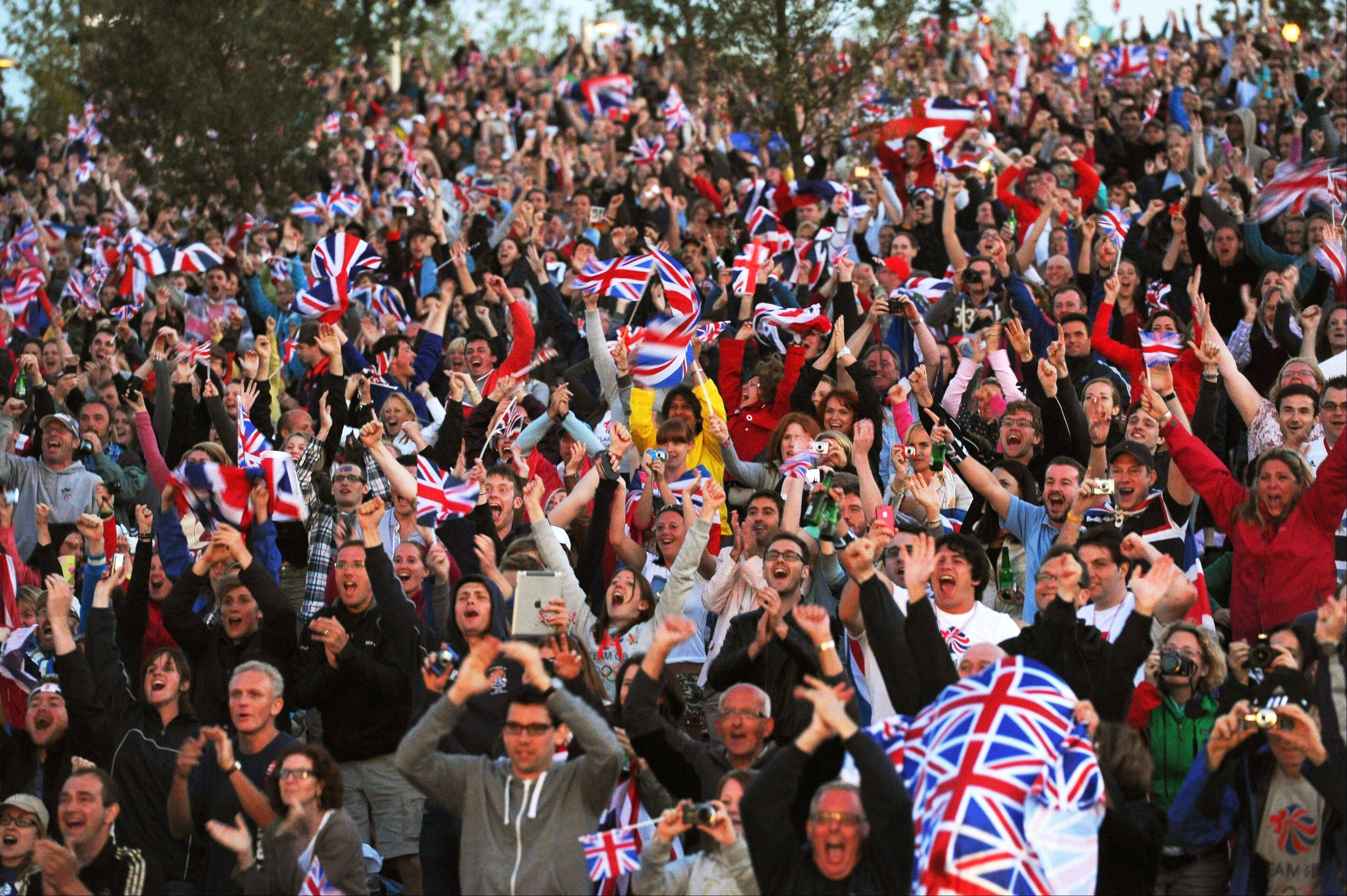Crowds cheer as they watch Great Britain's Jessica Ennis win gold in the women's heptathlon on the big screen in the Olympic Park on Saturday.