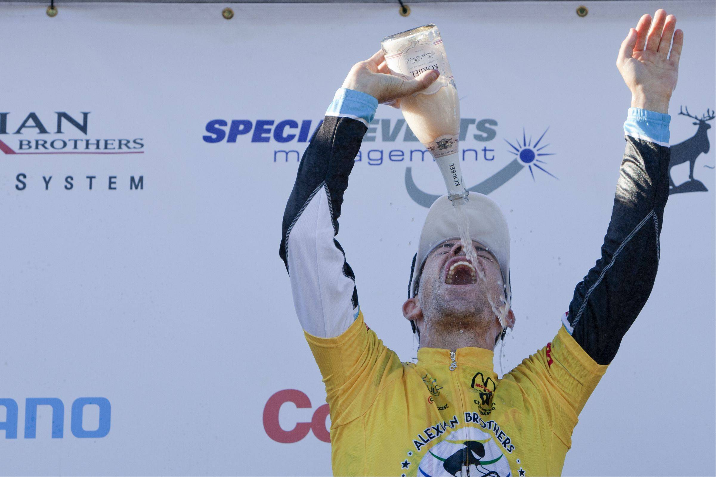 Francios Parisien of Team Spyder celebrates Sunday with a bottle of a champagne after winning the overall title in the Tour of Elk Grove Union Cycliste Internationale.