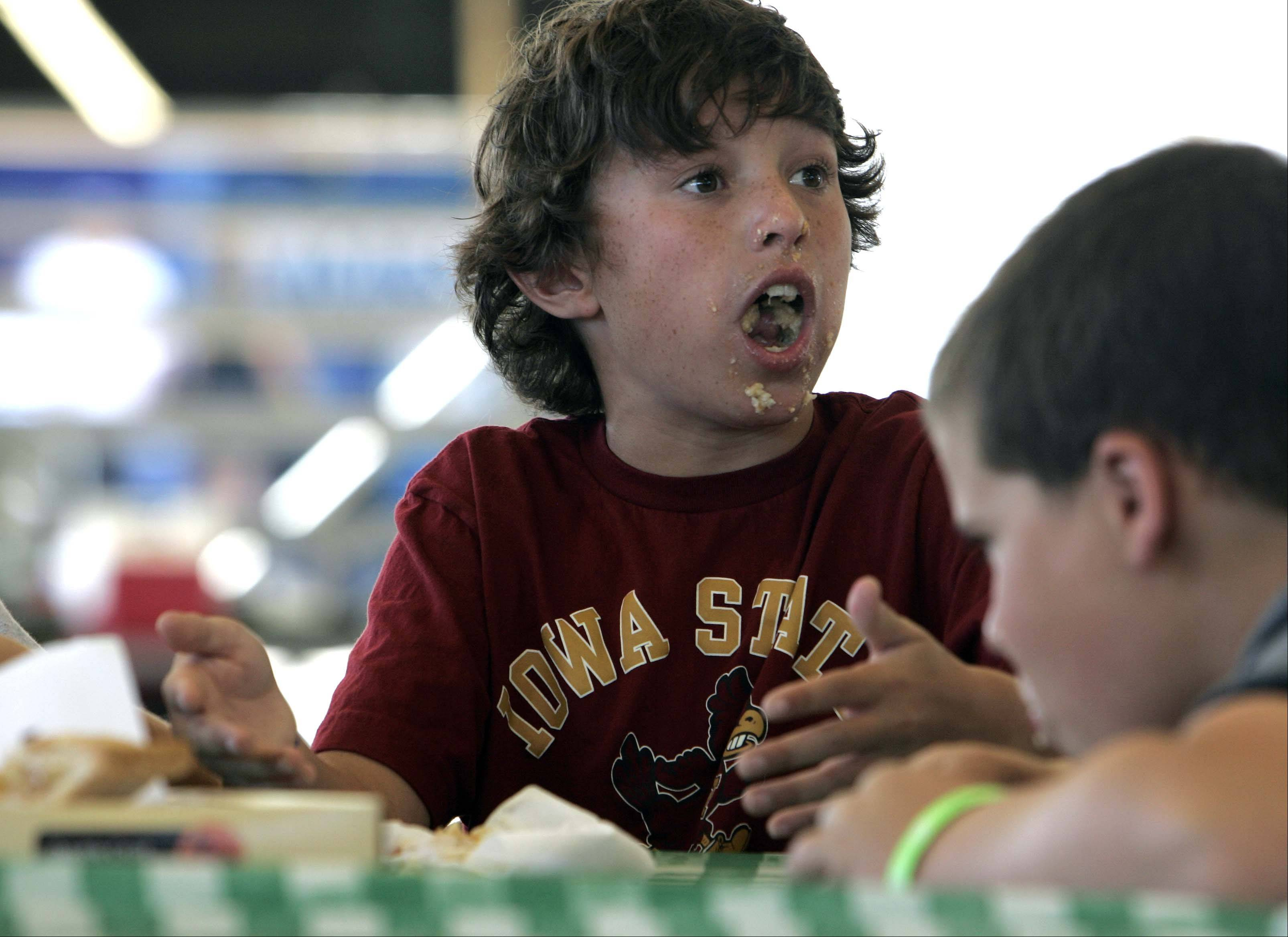 Twelve-year-old Ethan Dahl of Spring Grove can't believe that he did not win the pie eating contest at the McHenry County Fair Sunday August 5, 2012 in Woodstock.