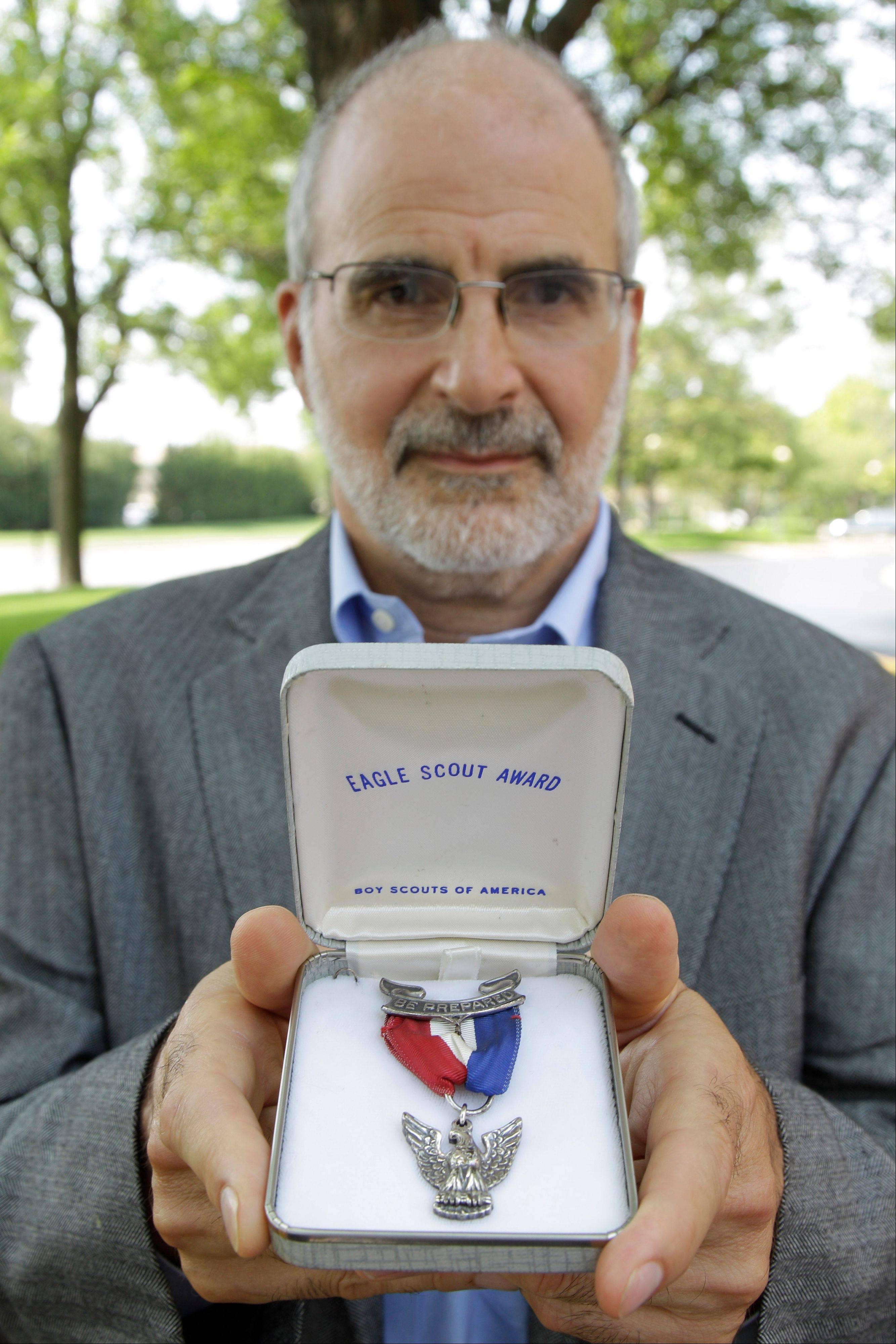 Dr. Robert Wise holds his Eagle Scout medal in Oakbrook Terrace. Wise, 59, is among several dozen former Eagle Scouts who are relinquishing their medals following the July 17 announcement that the Boy Scouts of America, after a confidential two-year review, was sticking with the divisive, long-standing policy of excluding openly gay youth and adults as members and leaders.