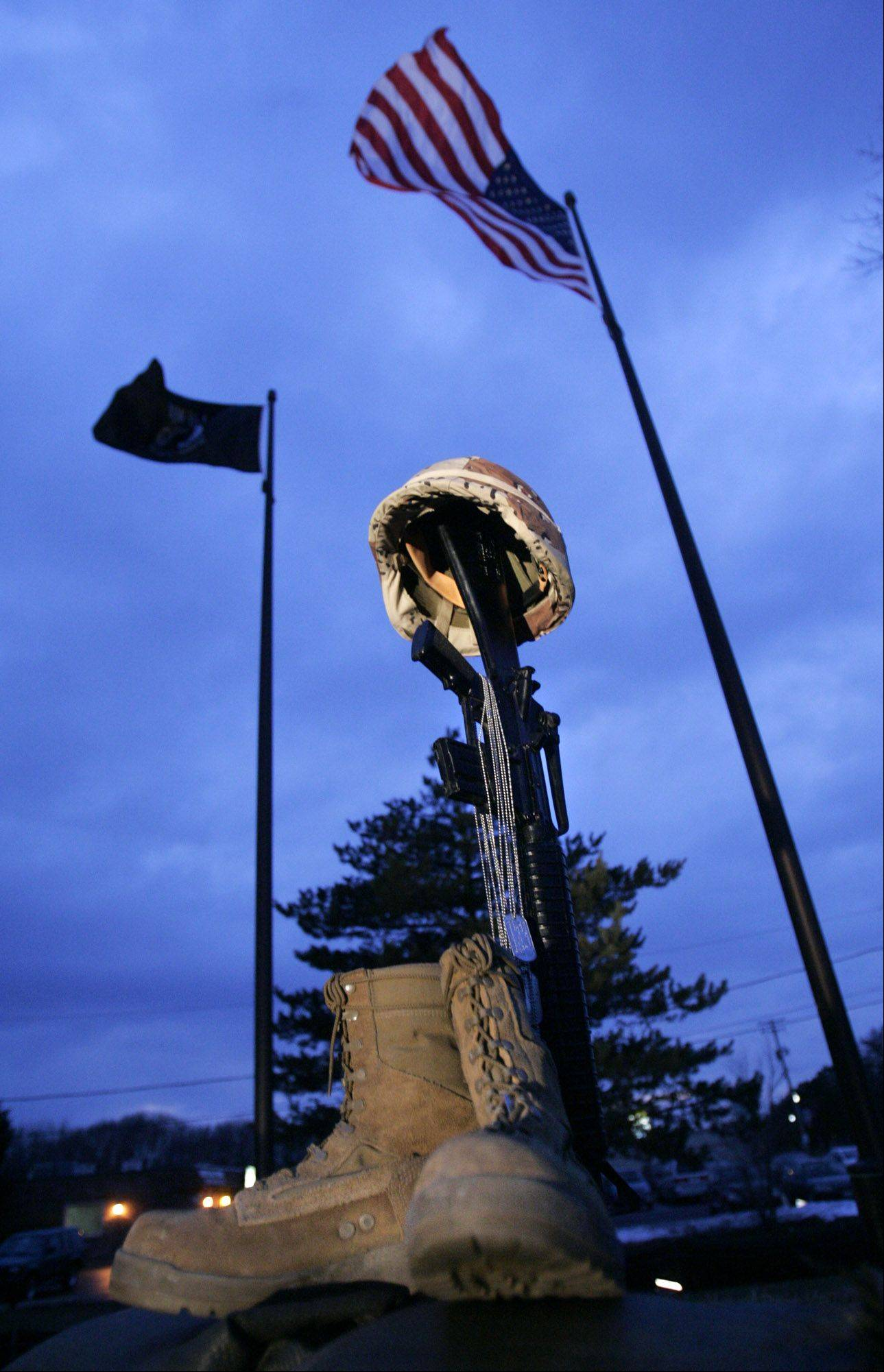 Boots, dog tags, a rifle and a helmet were in front of flags at Heroes of Freedom Memorial Park in Gurnee before a ceremony to honor a fallen Marine in 2006.