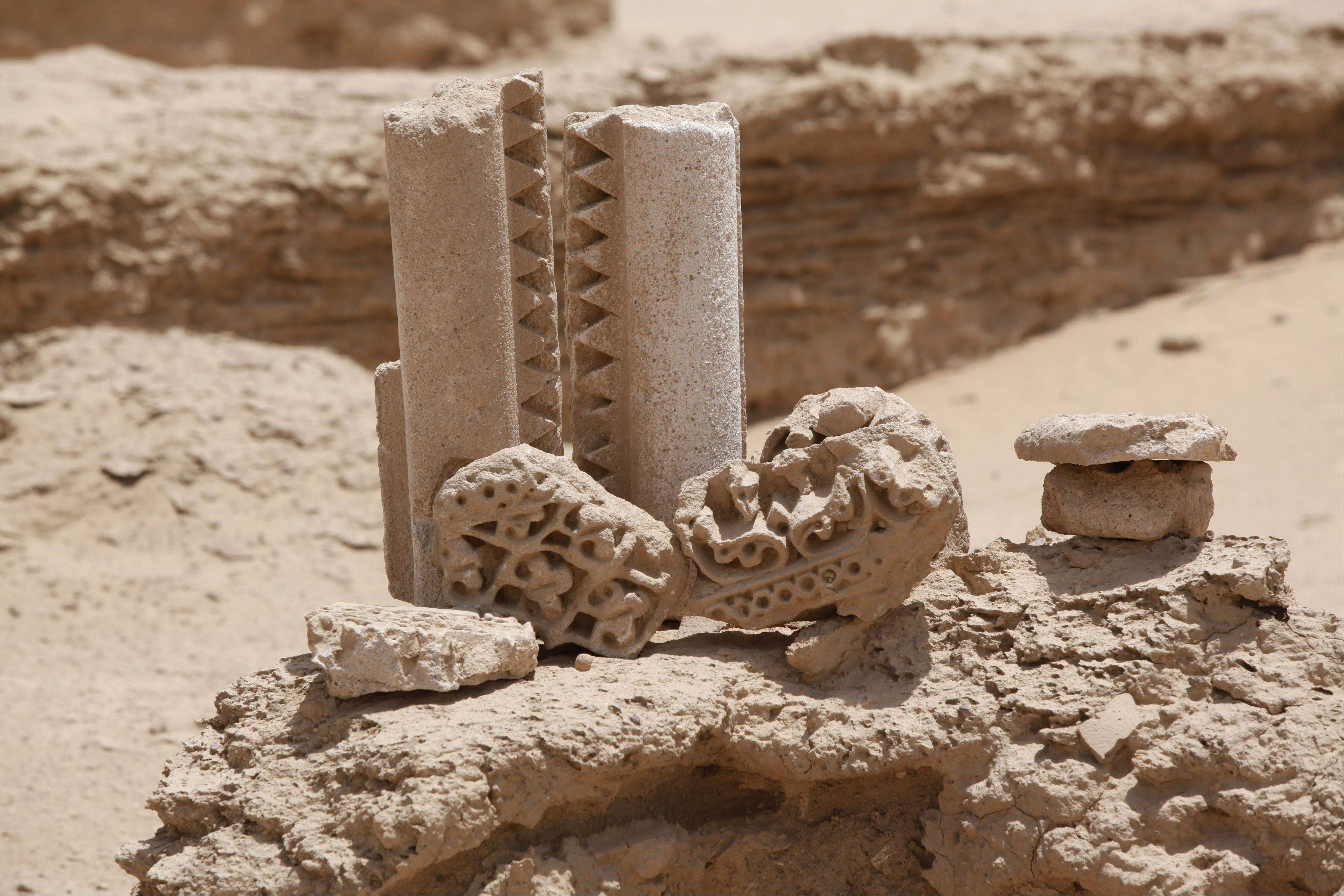 Artifacts from what scholars think may be from the legendary Arab Christian city of Hira are just a few hundred yards from the runway of the airport in the holy Shiite Muslim city of Najaf, about 100 miles south of Baghdad.