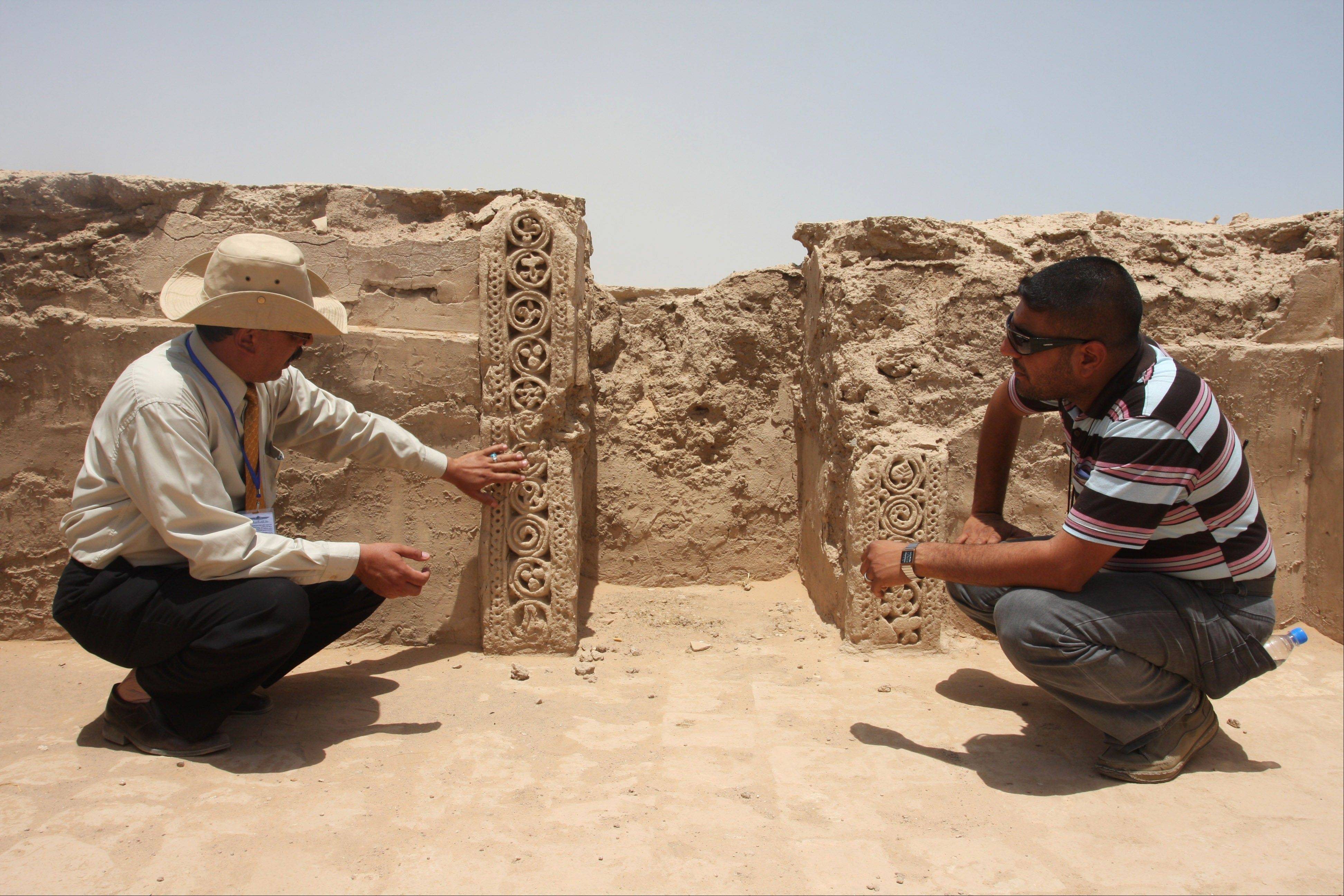 Archaeologists look at ruins that scholars think may be from the legendary Arab Christian city of Hira in Iraq on July 10.